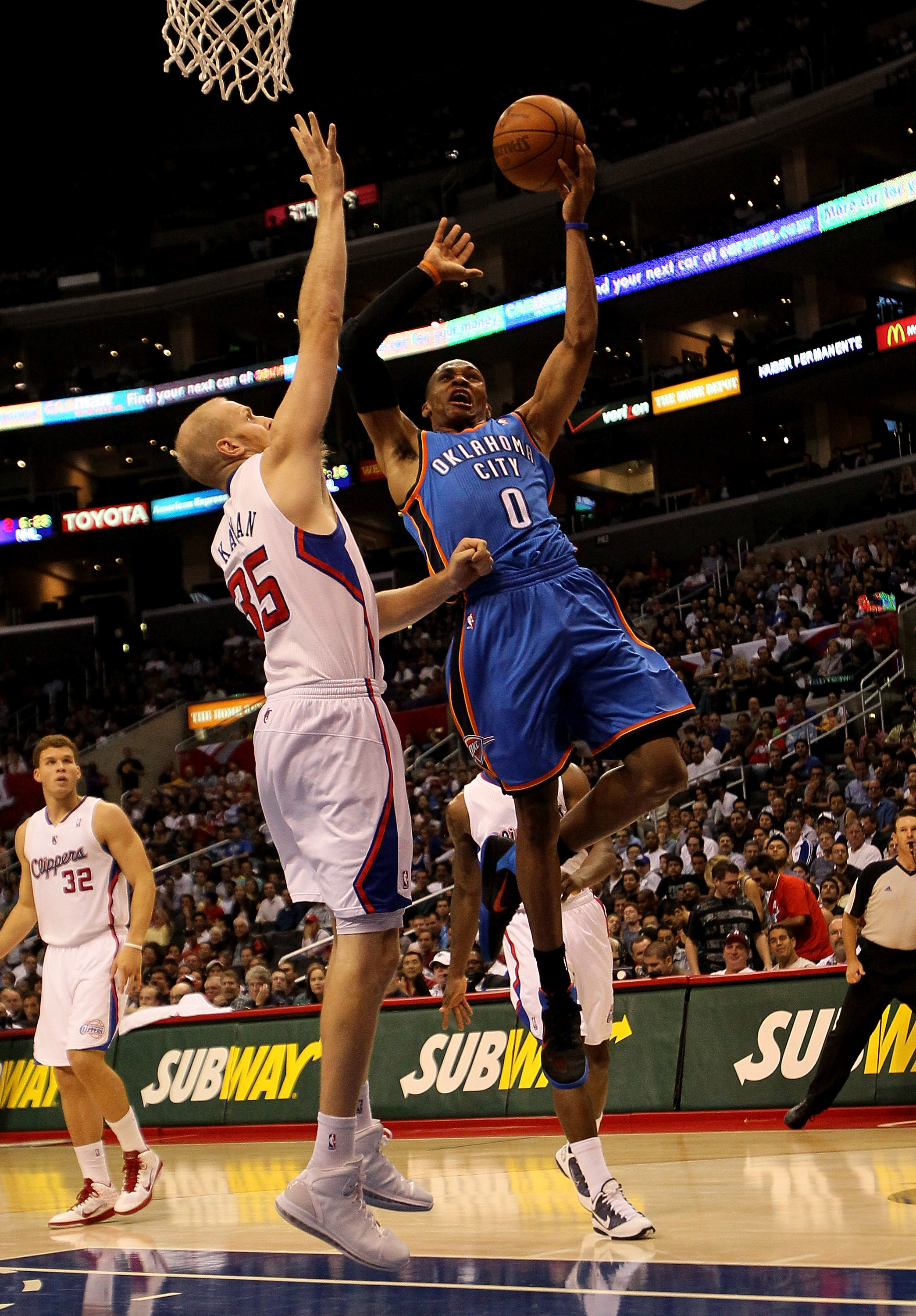 LOS ANGELES - NOVEMBER 3:  Russell Westbrook #0 of the Oklahoma City Thunder shoots over Chris Kaman #35 of the Los Angeles Clippers at Staples Center on November 3, 2010 in Los Angeles, California.   The Clippers won 107-92.  NOTE TO USER: User expressly