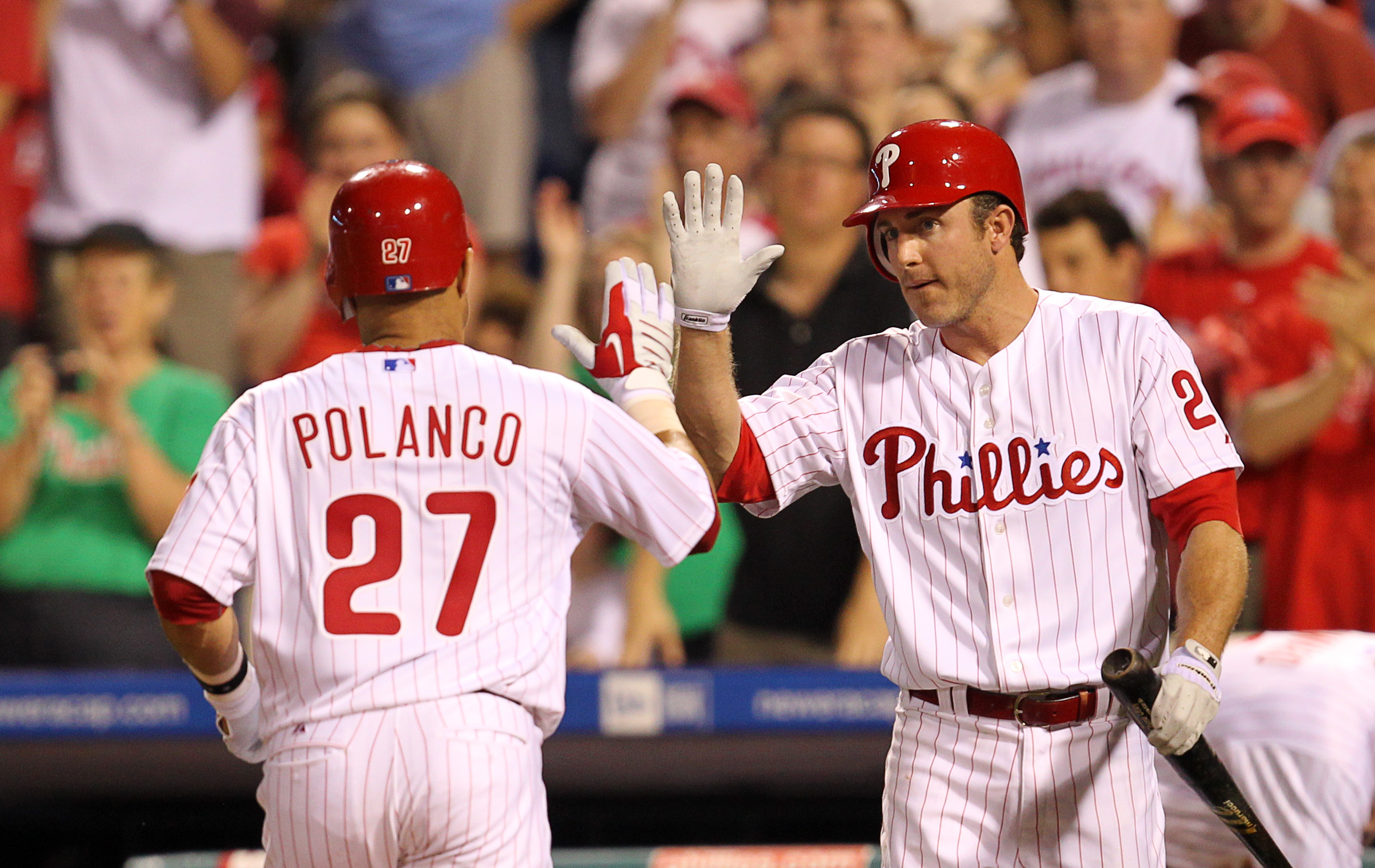 PHILADELPHIA - MAY 2: Third baseman Placido Polanco #27 is greeted by second baseman Chase Utley #26 of the Philadelphia Phillies after hitting a home run during a game against the New York Mets at Citizens Bank Park on May 2, 2010 in Philadelphia, Pennsy
