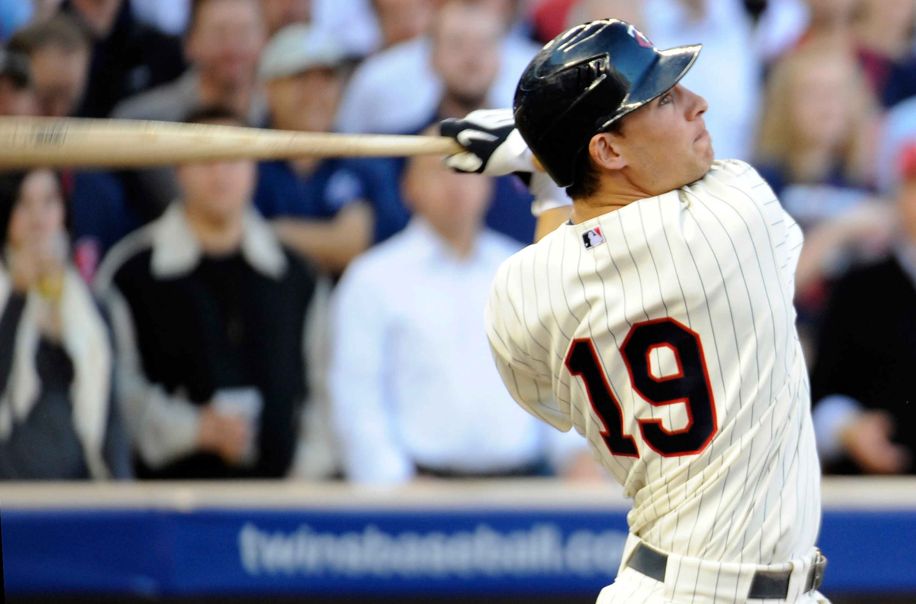 MINNEAPOLIS, MN - OCTOBER 7: Danny Valencia #19 of the Minnesota Twins hits an RBI sacrifice fly in the second inning during game two of the ALDS game against the New York Yankees on October 7, 2010 at Target Field in Minneapolis, Minnesota.  (Photo by Ha