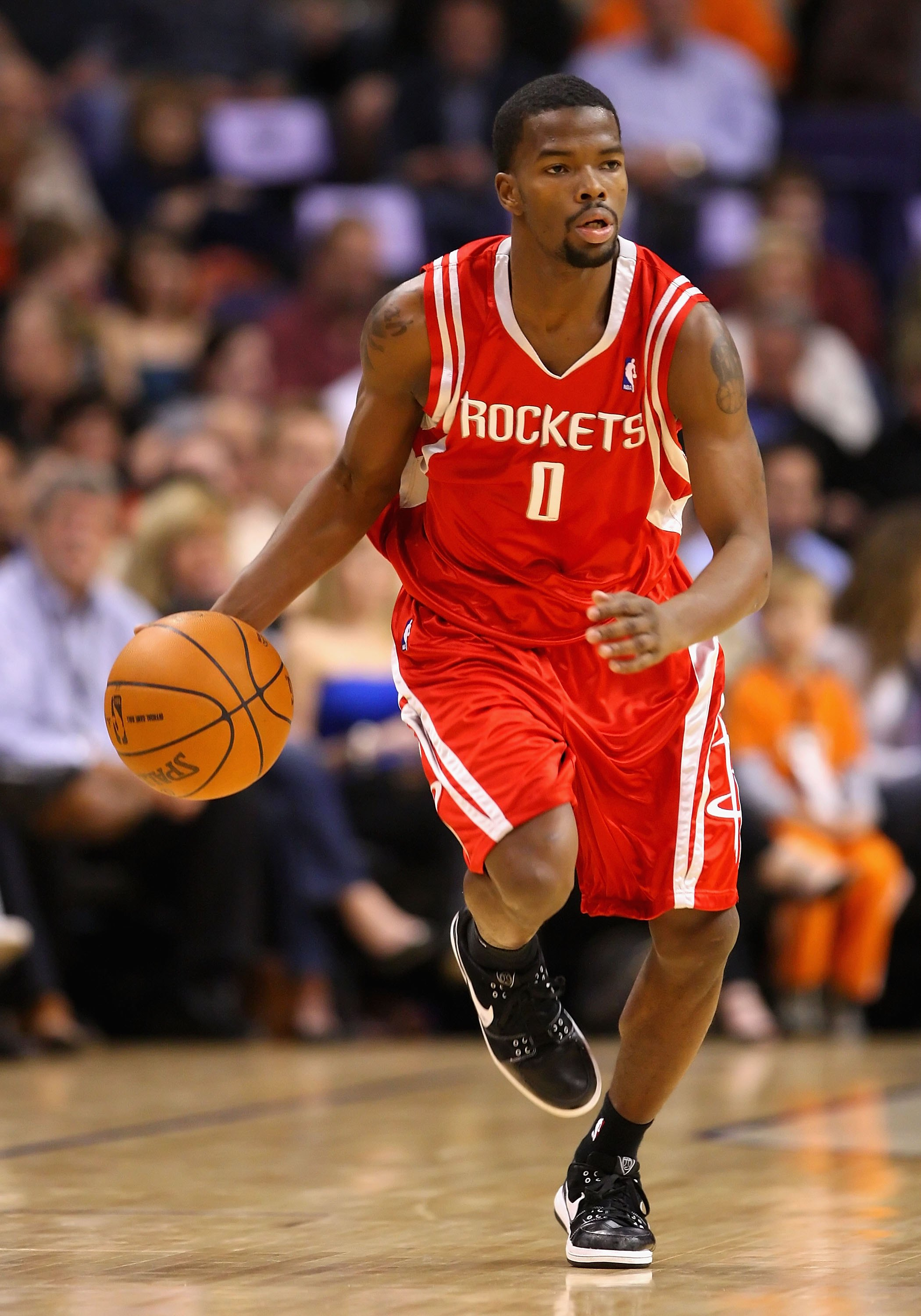 PHOENIX - JANUARY 06:  Aaron Brooks #0 of the Houston Rockets handles the ball during the NBA game against the Phoenix Suns at US Airways Center on January 6, 2010 in Phoenix, Arizona. The Suns defeated the Rockets 118-110.  NOTE TO USER: User expressly a