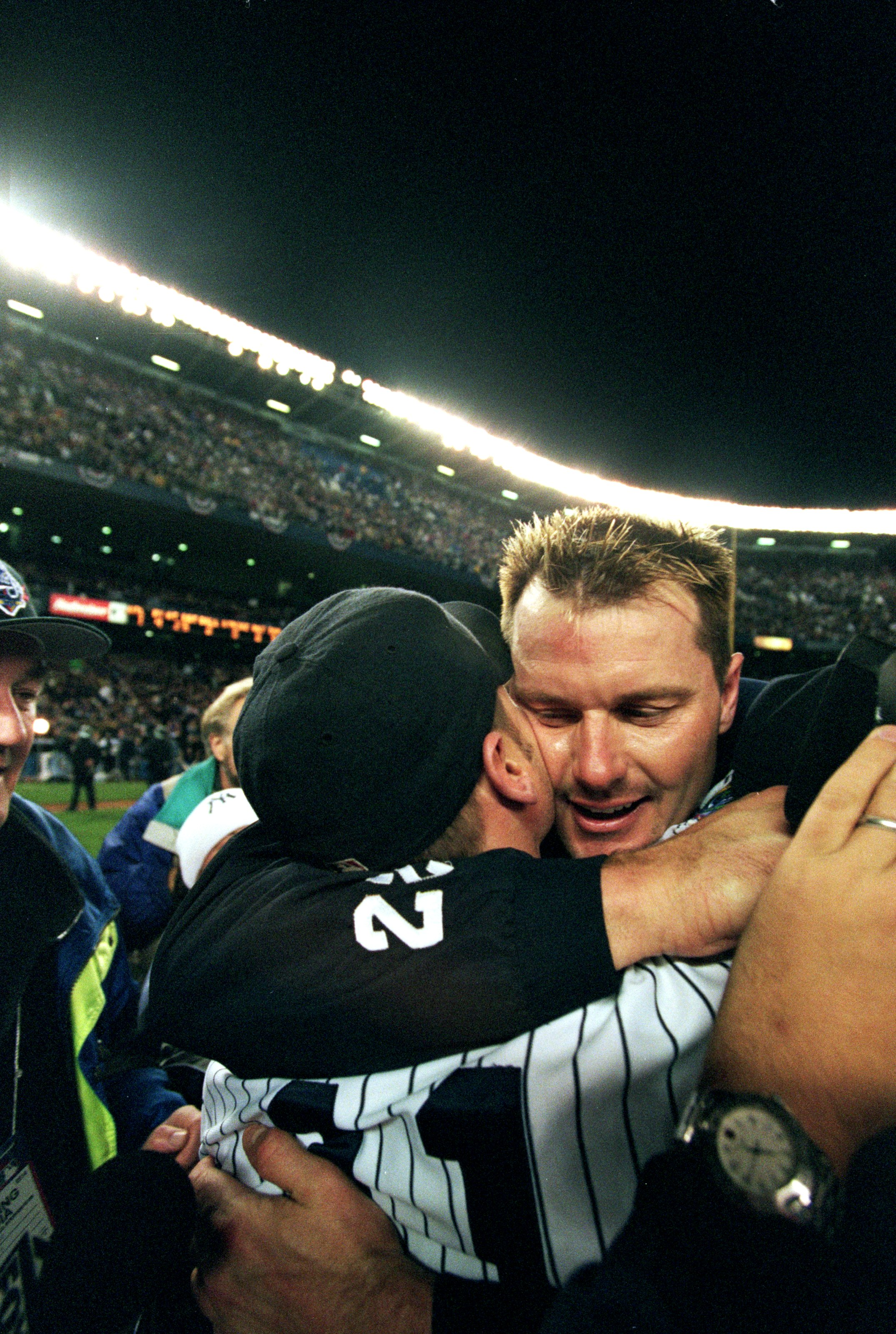 27 Oct 1999: Roger Clemens #22 of the New York Yankees hugs Chuck Knoblauch #11 after winning the World Series Game four against the Atlanta Braves at Yankee Stadium in the Bronx, New York. The Yankees defeated the Braves 4-1.