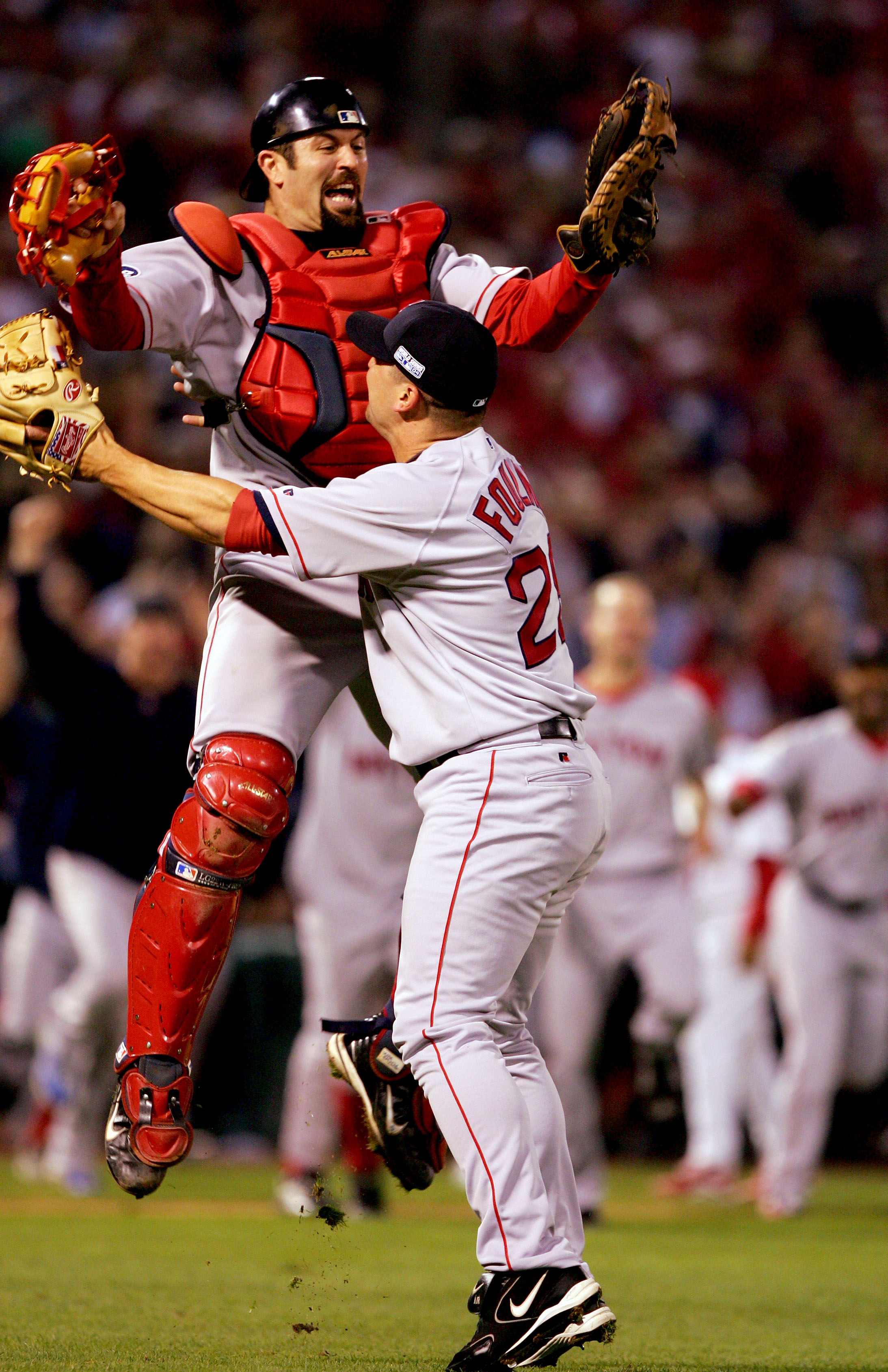 ST LOUIS - OCTOBER 27:  Jason Varitek #33 and Keith Foulke #29 of the Boston Red Sox celebrate after defeating the St. Louis Cardinals 3-0 in game four of the World Series on October 27, 2004 at Busch Stadium in St. Louis, Missouri.(Photo by Jed Jacobsohn
