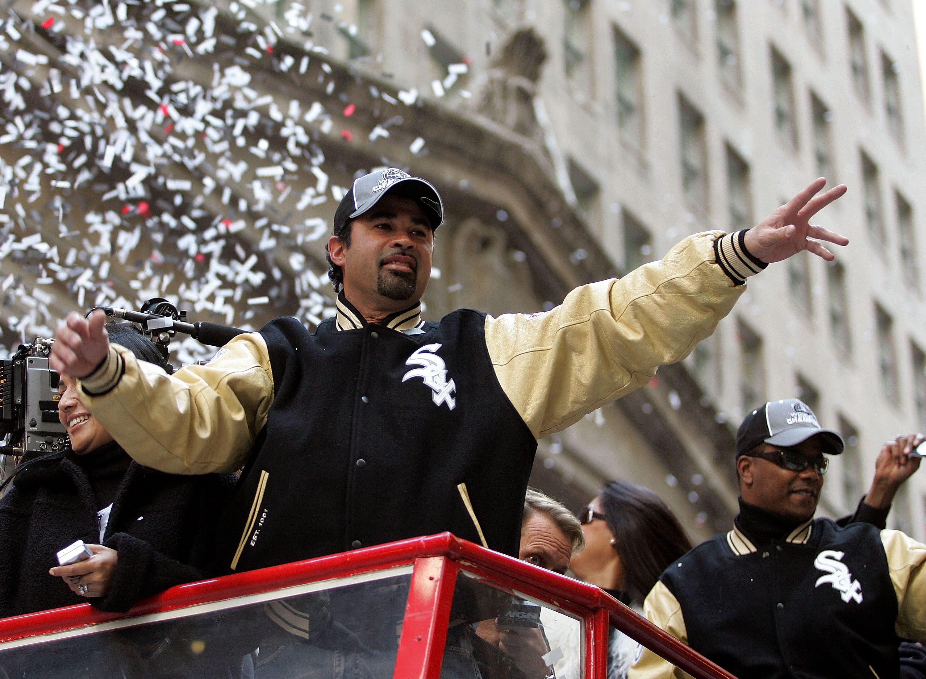 CHICAGO - OCTOBER 28:  Chicago White Sox manager Ozzie Guillen waves to fans from a double-decker bus during a ticker-tape parade for the White Sox baseball team October 28, 2005 in downtown Chicago, Illinois. The Chicago White Sox won their first World S