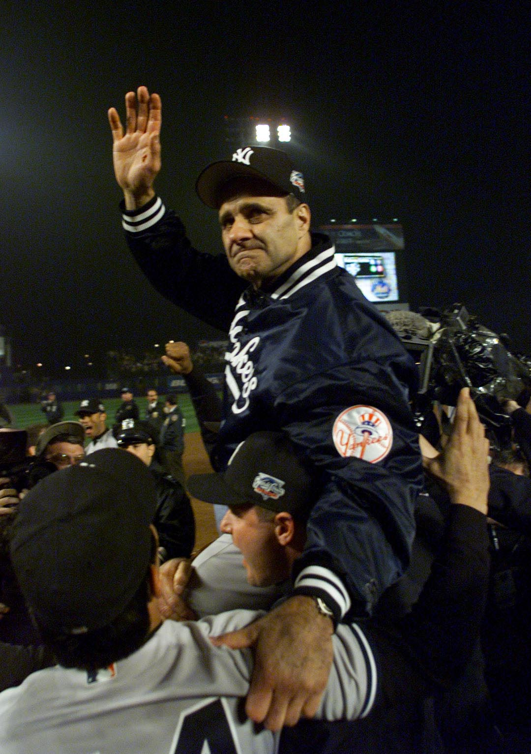 26 Oct 2000:  Manager Joe Torre of the New York Yankees celebrates their 4-2 win over the New York Mets to win their third consecutive World Series Championship at Shea Stadium in Flushing, New York. <DIGITAL IMAGE> Mandatory Credit: Jed Jacobsohn/ALLSPOR