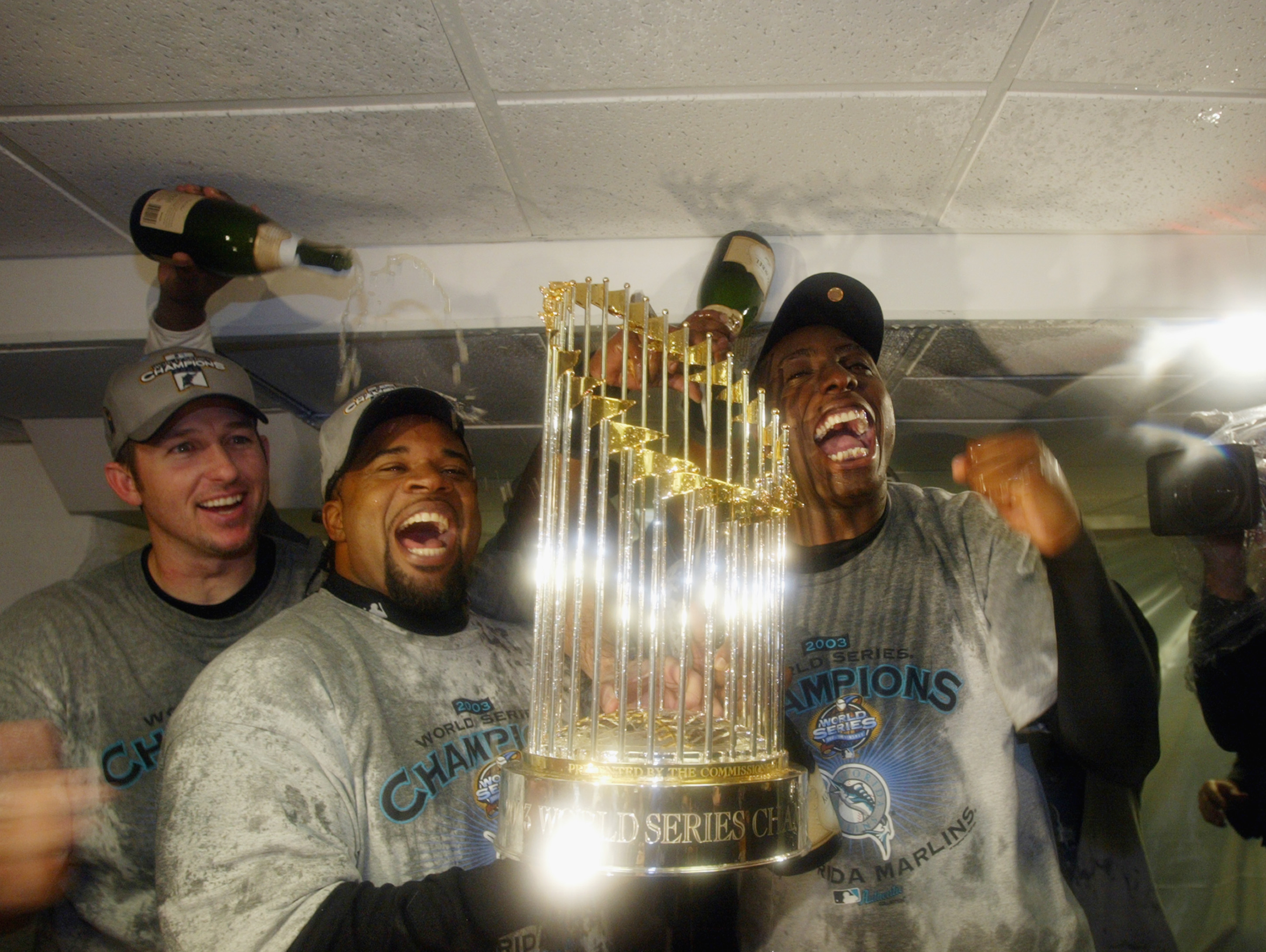 BRONX, NY - OCTOBER 25:  Florida Marlins players celebrate with the World Series Trophy after defeating the New York Yankees in game six of the Major League Baseball World Series on October 25, 2003 at Yankee Stadium in the Bronx, New York.  The Marlins w