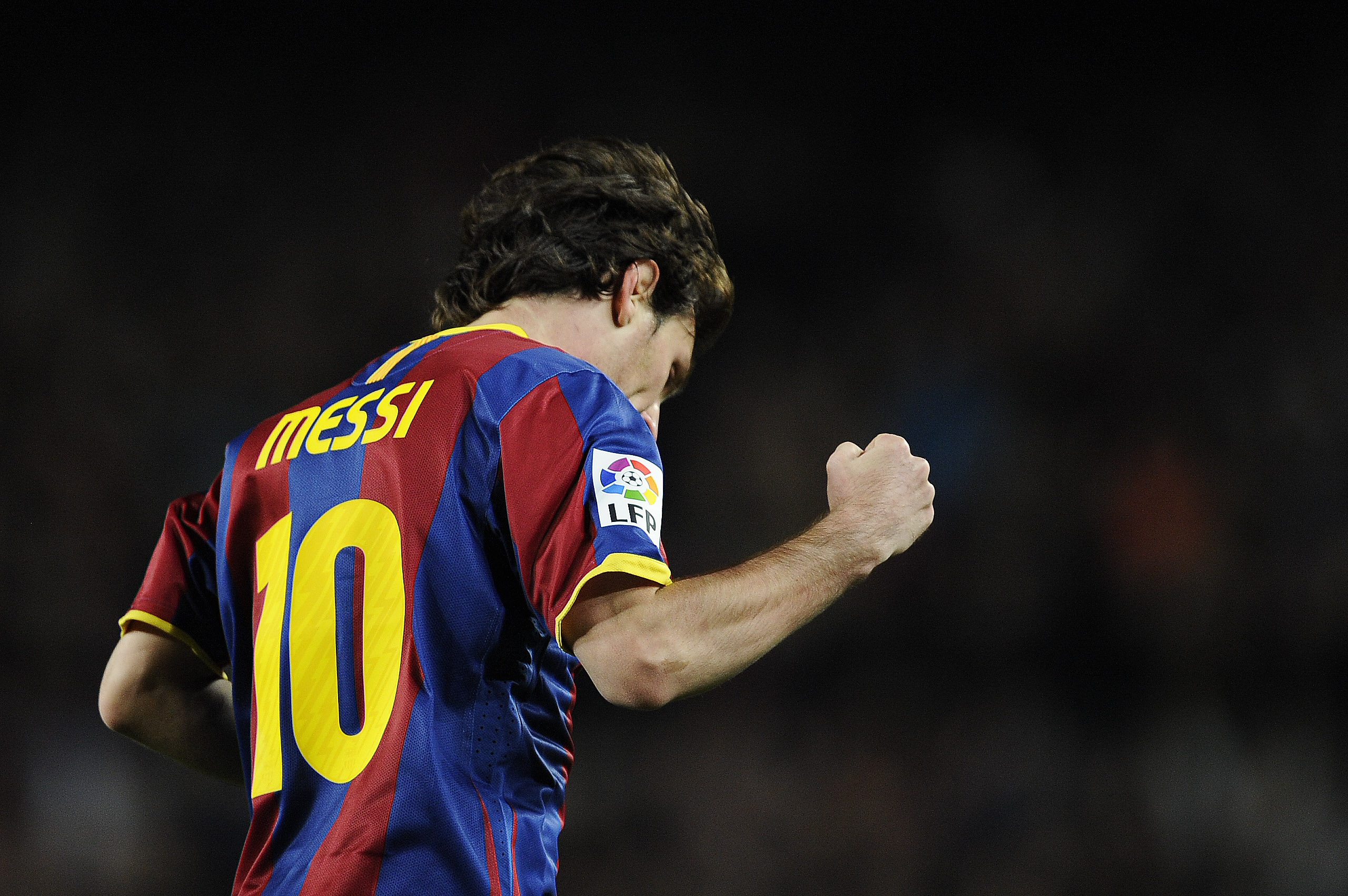 BARCELONA, SPAIN - OCTOBER 30:  Lionel Messi of Barcelona celebrates after scoring his second goal during the La Liga match between Barcelona and Sevilla FC on October 30, 2010 in Barcelona, Spain. Barcelona won the match 5-0.  (Photo by David Ramos/Getty