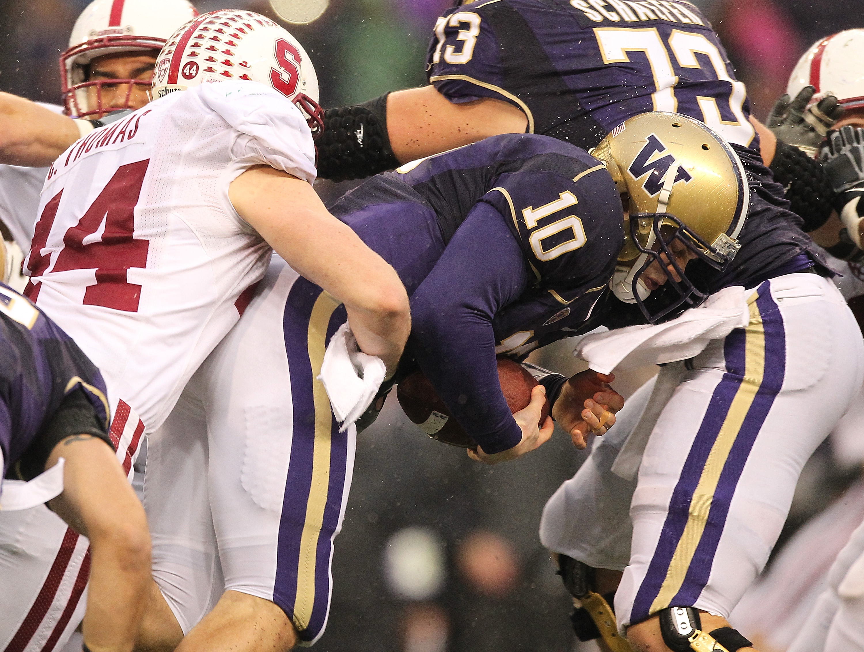 SEATTLE - OCTOBER 30:  Quarterback Jake Locker #10 of the Washington Huskies is tackled by Chase Thomas #44 of the Stanford Cardinal on October 30, 2010 at Husky Stadium in Seattle, Washington. (Photo by Otto Greule Jr/Getty Images)