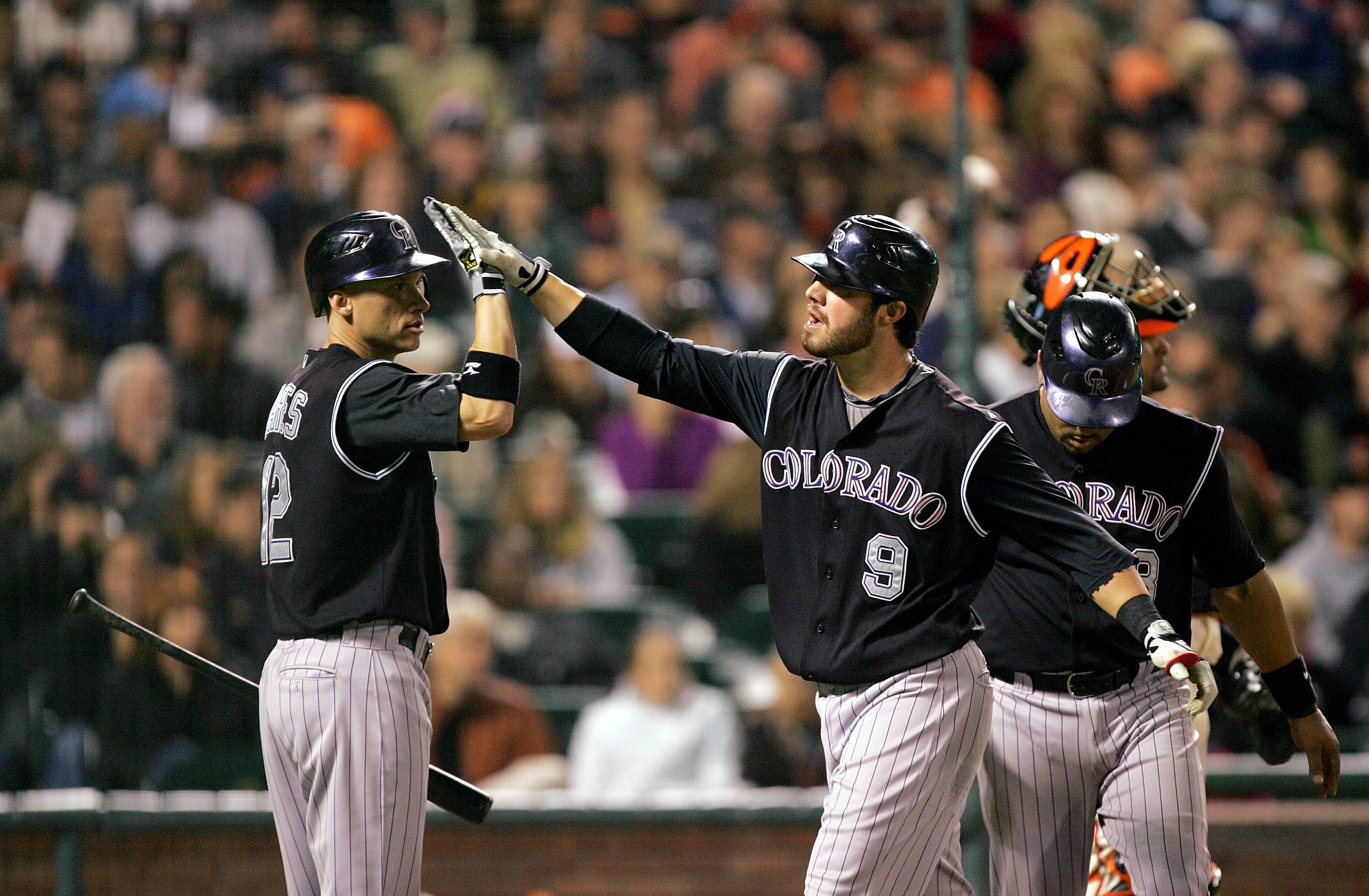 SAN FRANCISCO - SEPTEMBER 16:  Ian Stewart #9 of the Colorado Rockies is congratulated by Clint Barmes #12 after he hit a two-run home run to give the Rockies a 4-0 lead over the San Francisco Giants in the sixth inning of their game at AT&T Park on Septe