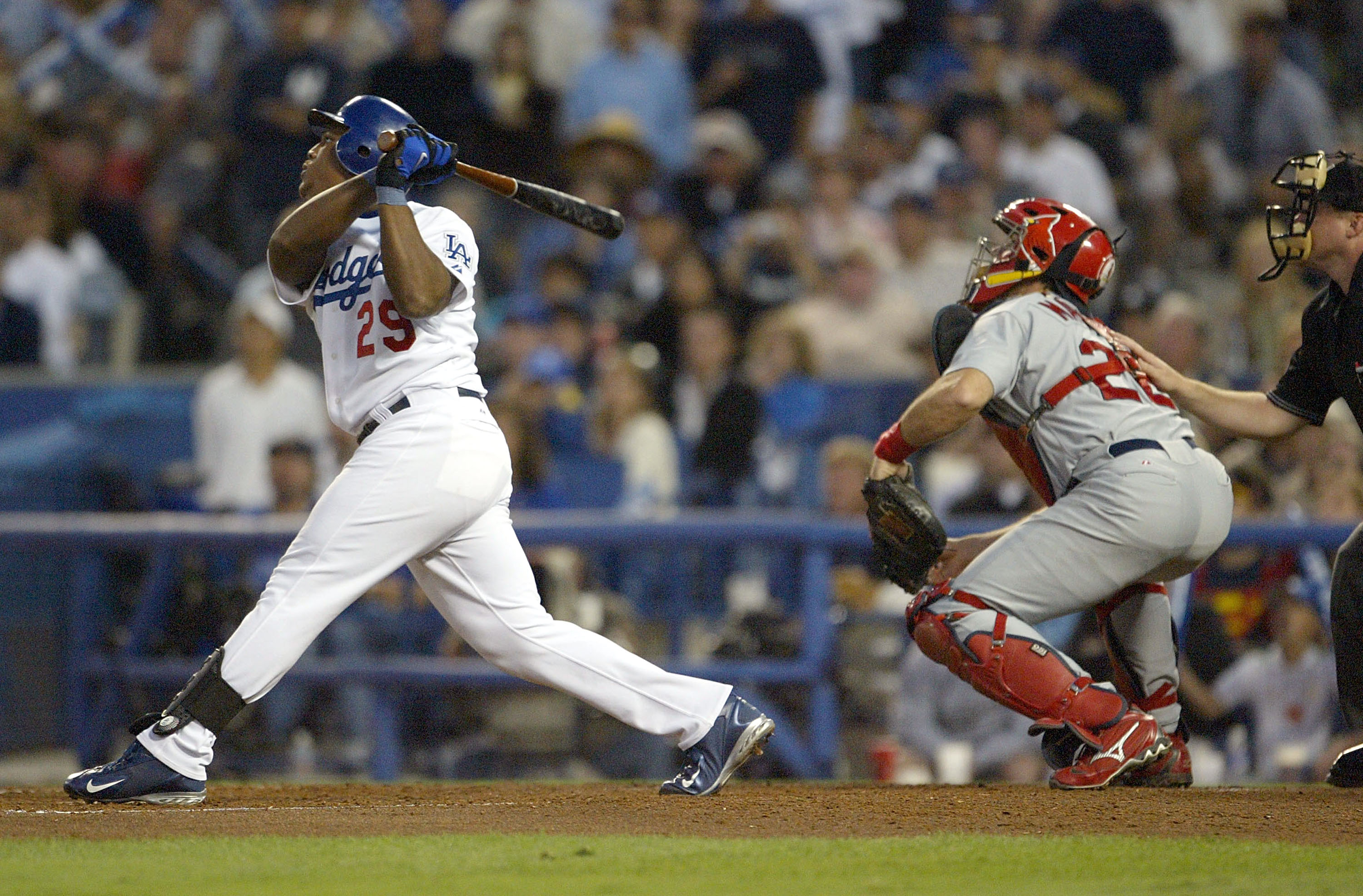 LOS ANGELES - OCTOBER 10:  Adrian Beltre #29 of the Los Angeles Dodgers hits a sacrifice fly that allowed Jayson Werth #28 to score in the third inning of the National League Division Series, Game Four on October 10, 2004 at Dodger Stadium in Los Angeles,