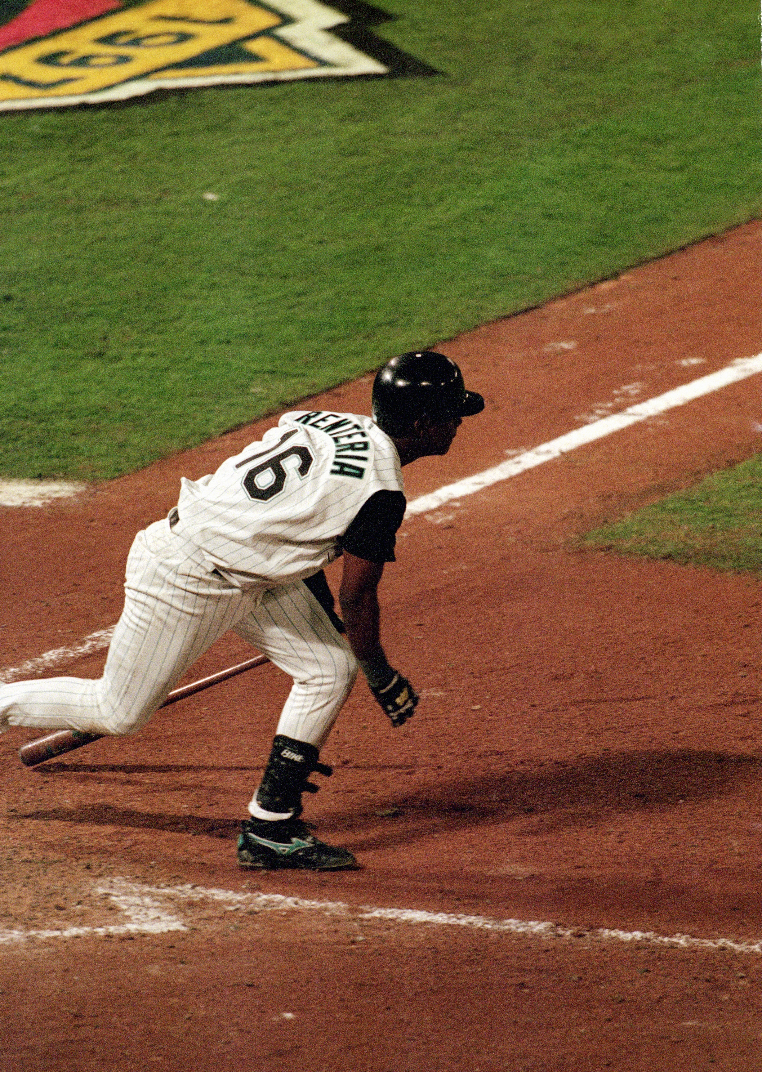 MIAMI - OCTOBER 26:  Edgar Renteria #16 of the Florida Marlins singles to center to drive in the game winning run during Game seven of the 1997 World Series against the Cleveland Indians at Pro Player Stadium on October 26, 1997 in Miami, Florida. The Mar