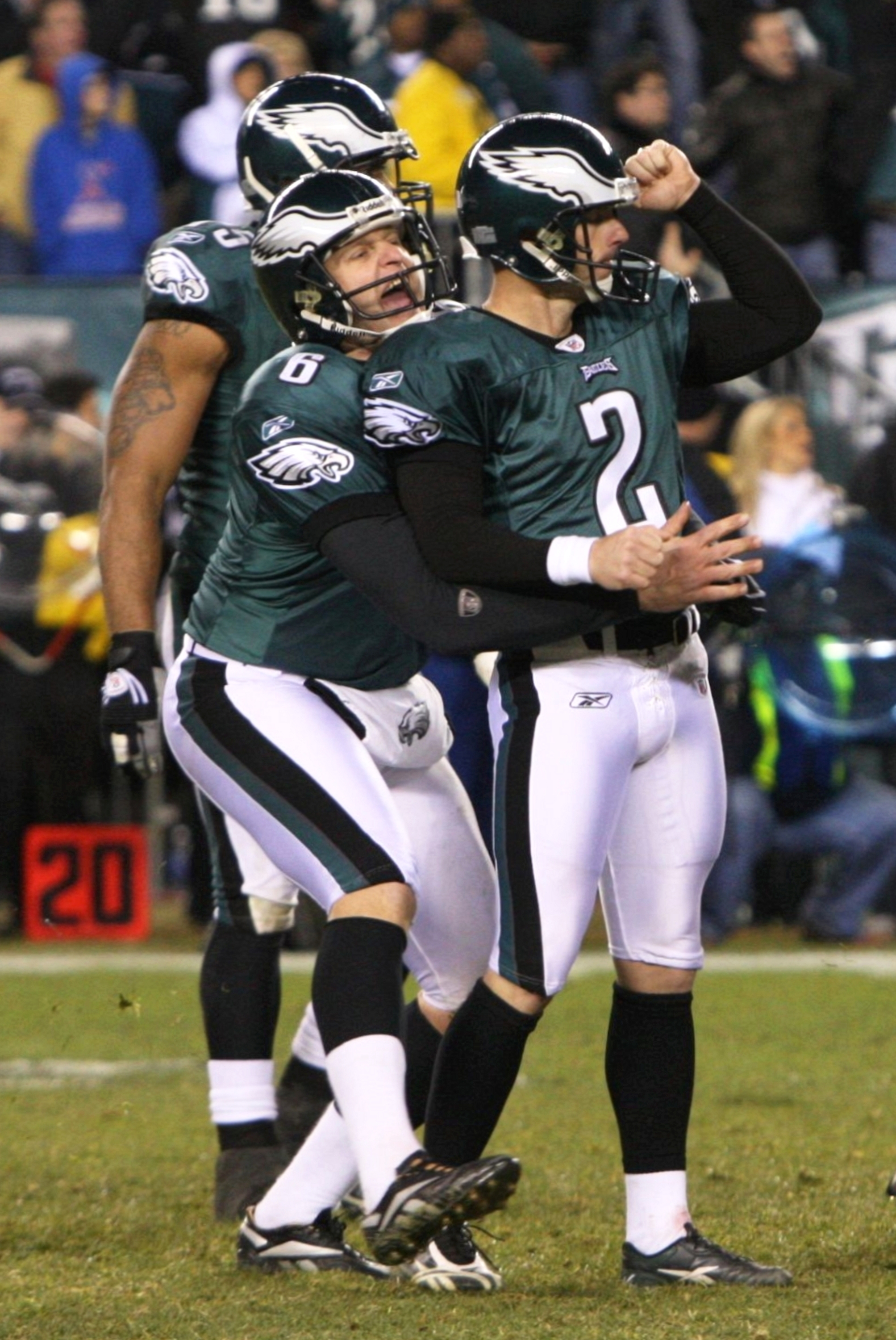 PHILADELPHIA - DECEMBER 27 : David Akers #2 of the Philadelphia Eagles gets lifted by teammate Sav Rocca #6 after kicking the game winning field goal against the Denver Broncos at Lincoln Financial Field on December 27, 2009 in Philadelphia, Pennsylvania.