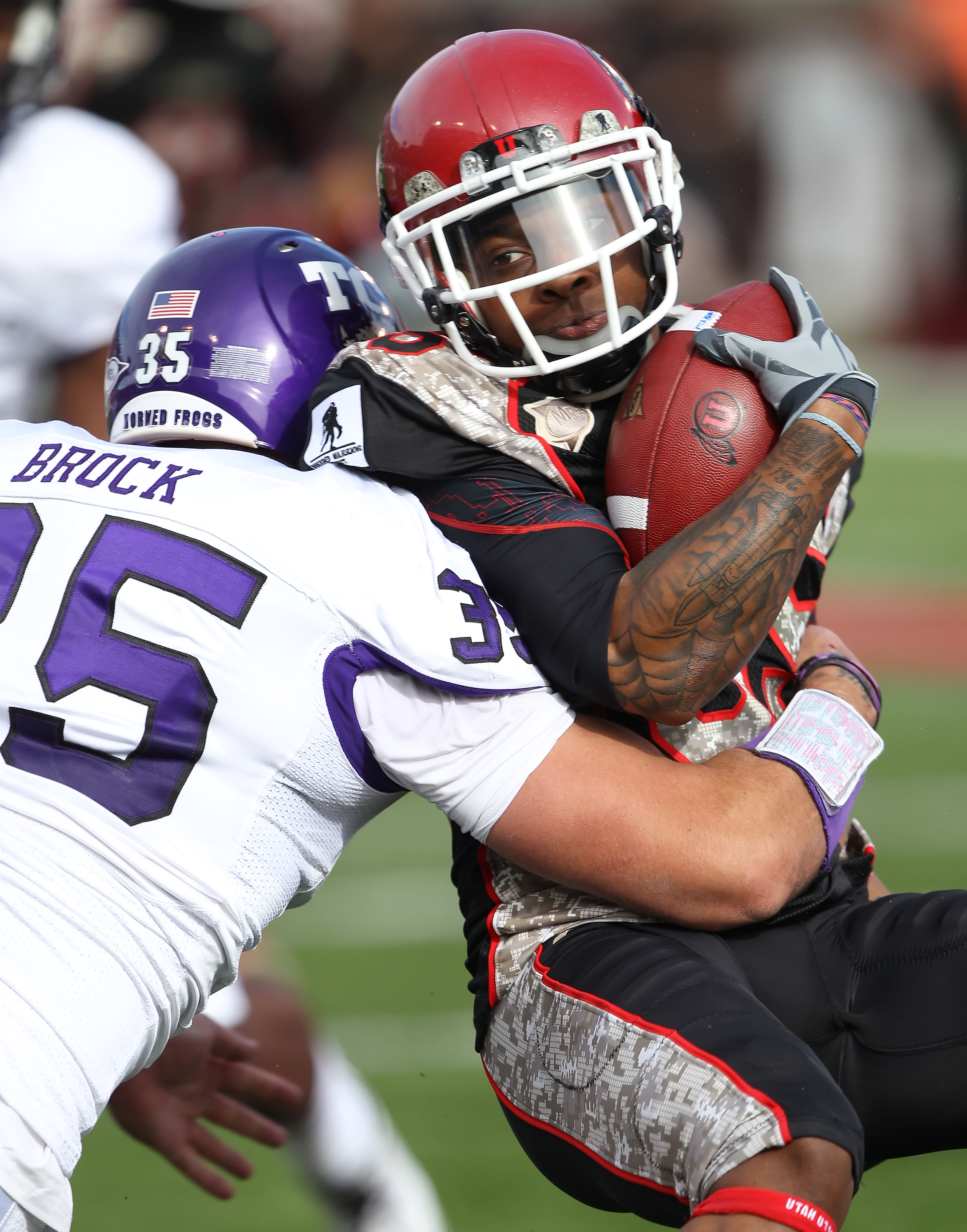 SALT LAKE CITY, UT - NOVEMBER 6: Jereme Brooks #85 of the Utah Utes is hit by Tanner Brock #35 of the TCU Horned Frogs during the first half of an NCAA football game November 6, 2010 at Rice-Eccles Stadium in Salt Lake City, Utah. (Photo by George Frey/Ge