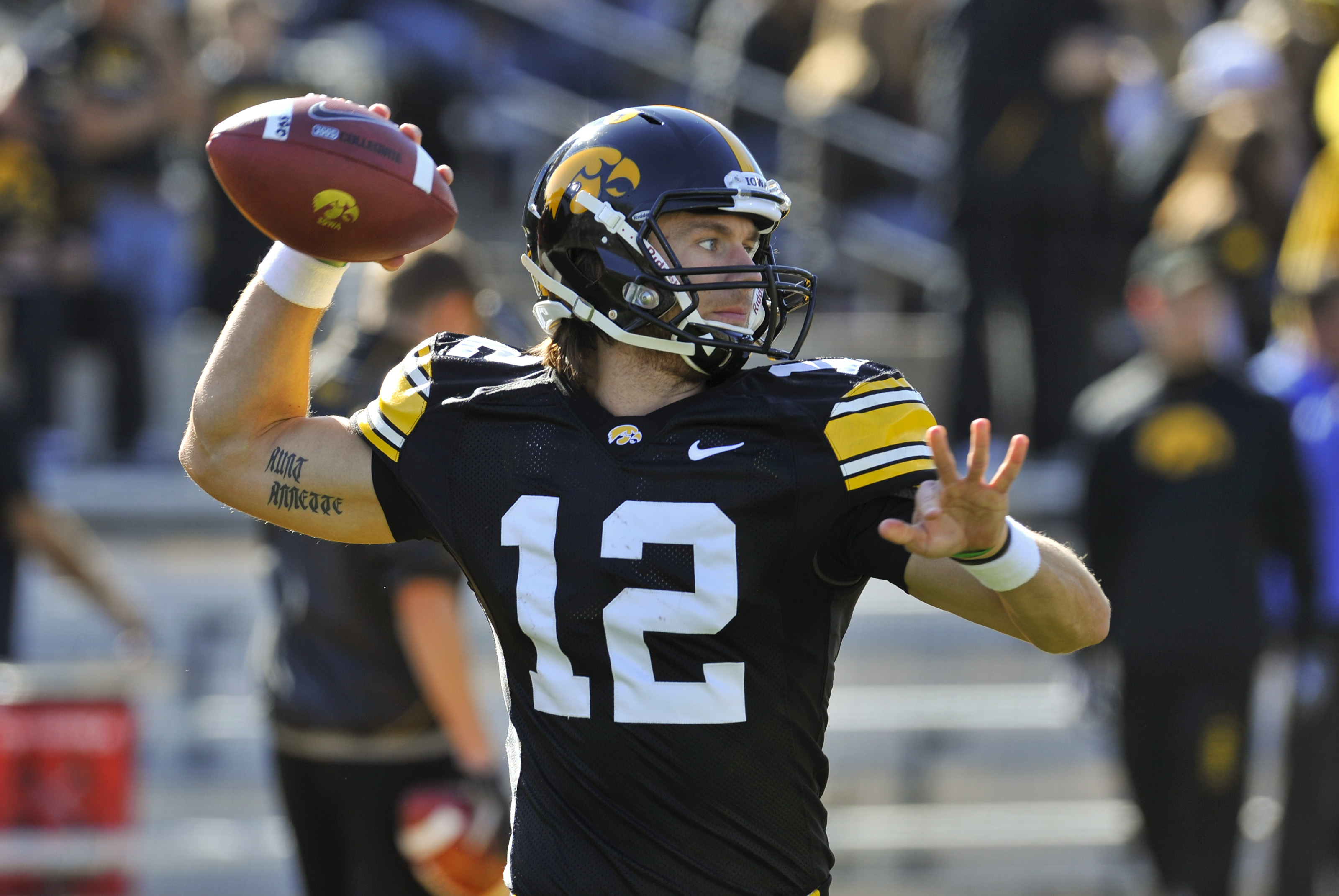 IOWA CITY, IA - OCTOBER 30- Quarterback Ricky Stanzi #12 of the University of Iowa Hawkeyes warms up his throwing arm before play against the Michigan State Spartans at Kinnick Stadium on October 30, 2010 in Iowa City, Iowa. Iowa won 37-6 over Michigan St