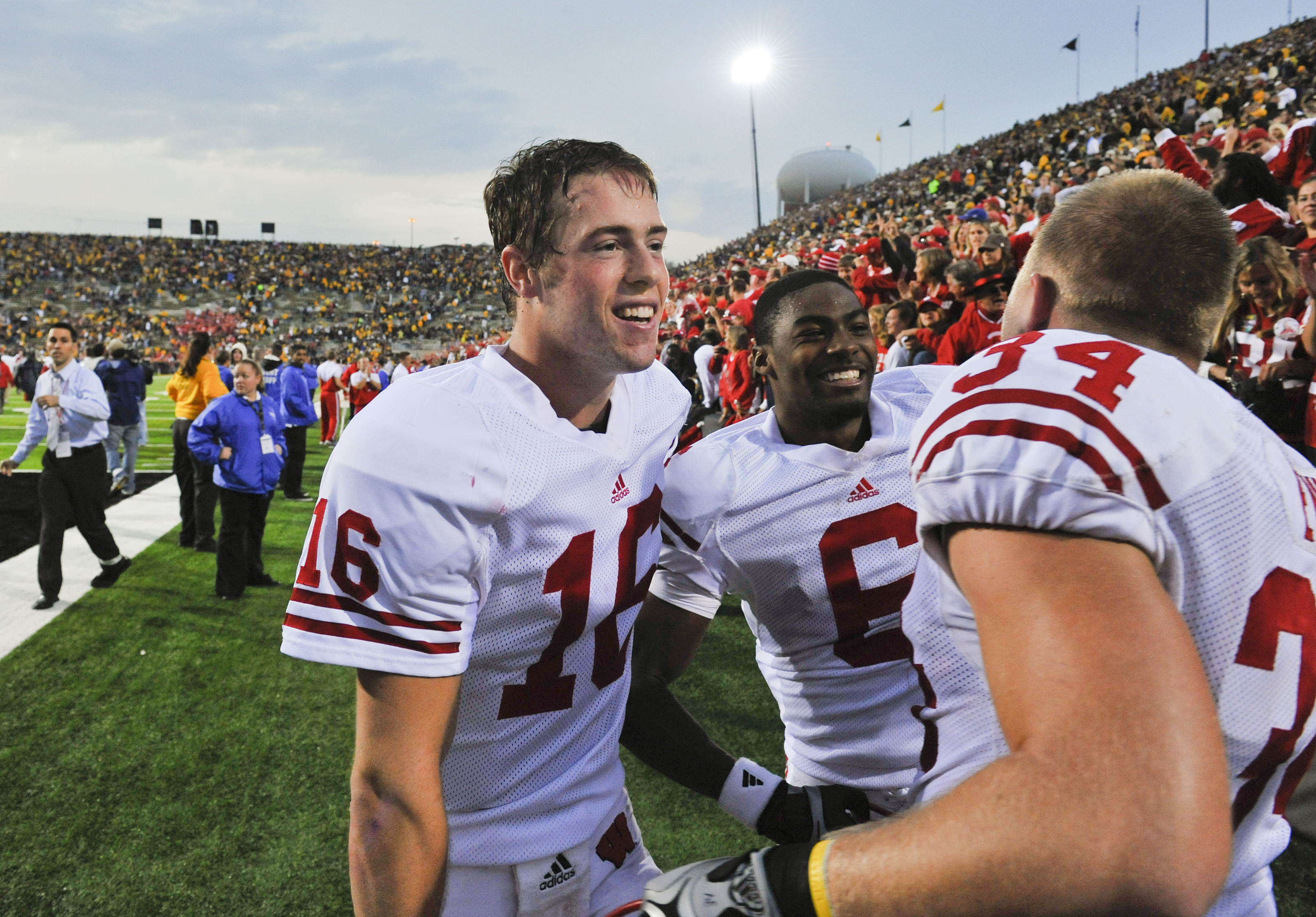 IOWA CITY, IA - OCTOBER 23- Quarterback Scott Tolzien #16 of the Wisconsin Badgers celebrates with teammates Isaac Anderson #6 and Bradie Ewing #34 after their the University of Iowa Hawkeyes at Kinnick Stadium on October 23, 2010 in Iowa City, Iowa. Wisc