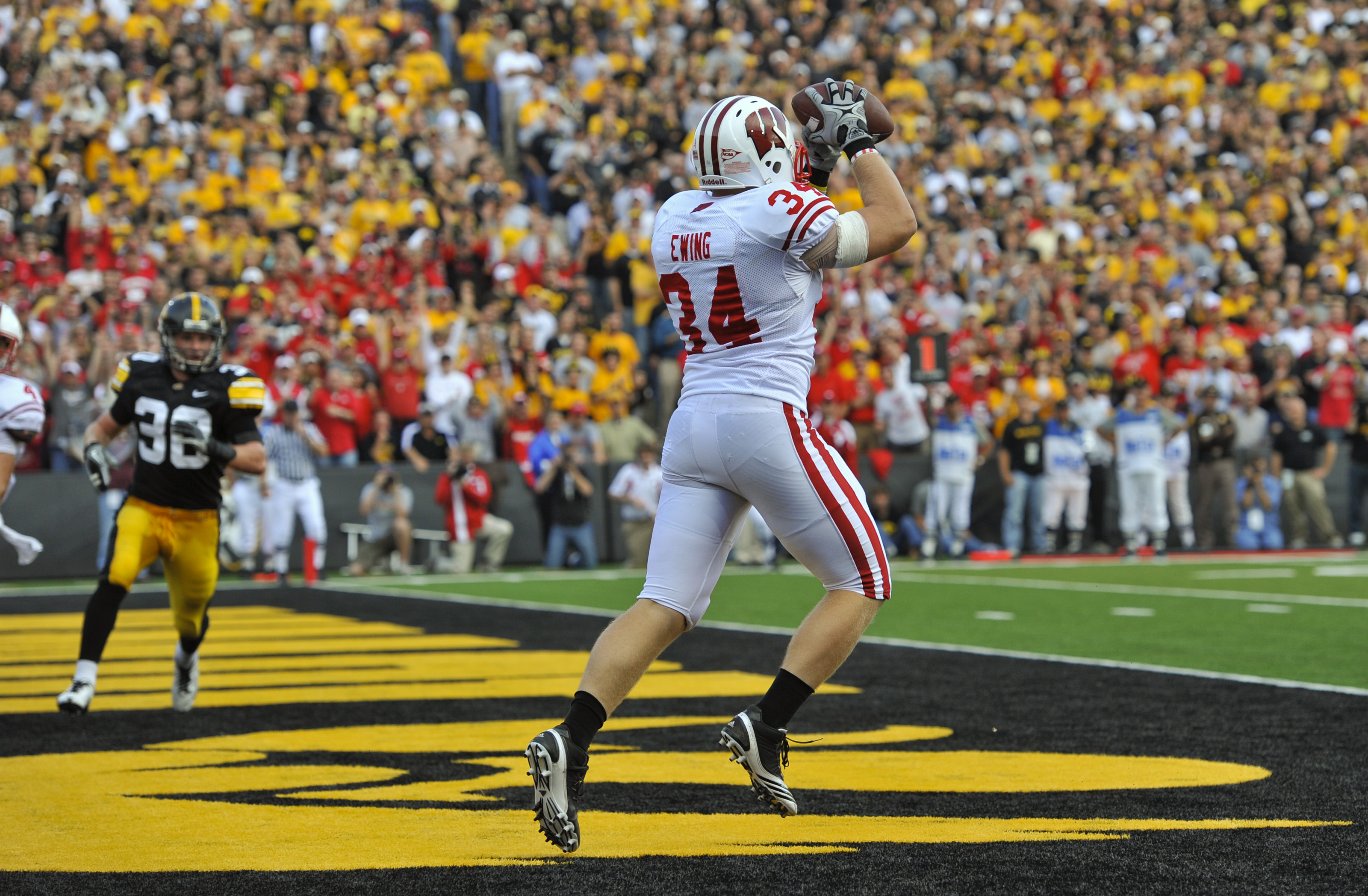IOWA CITY, IA - OCTOBER 23- Running back Bradie Ewing #34 of the Wisconsin Badgers catches a touchdown pass during the first half of play against the University of Iowa Hawkeyes at Kinnick Stadium on October 23, 2010 in Iowa City, Iowa. Wisconsin won 31-3