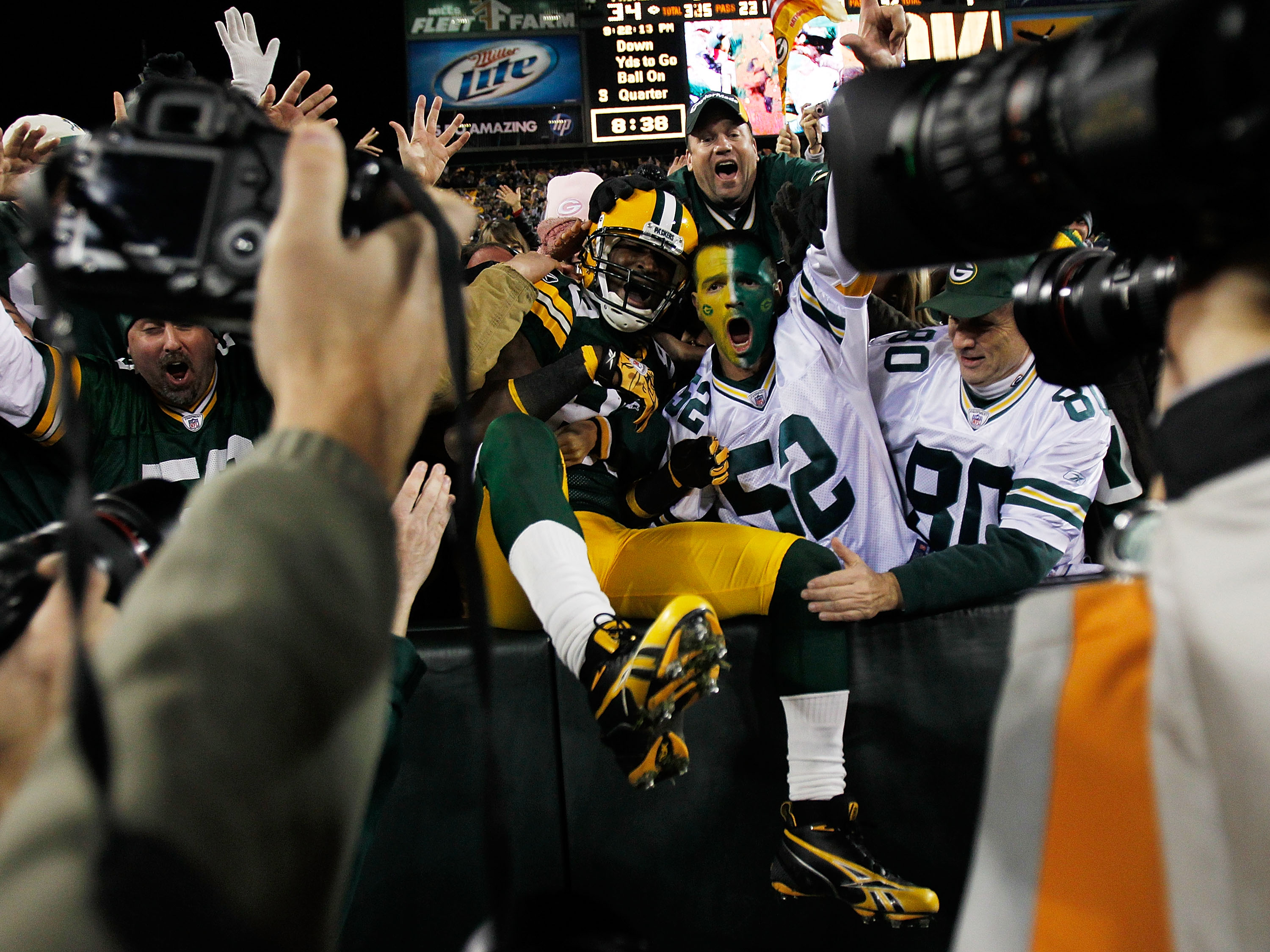 GREEN BAY, WI - NOVEMBER 07: James Jones #89 of the Green Bay Packers celebrates a touchdown with fans against the Dallas Cowboys at Lambeau Field on November 7, 2010 in Green Bay, Wisconsin. (Photo by Jonathan Daniel/Getty Images)
