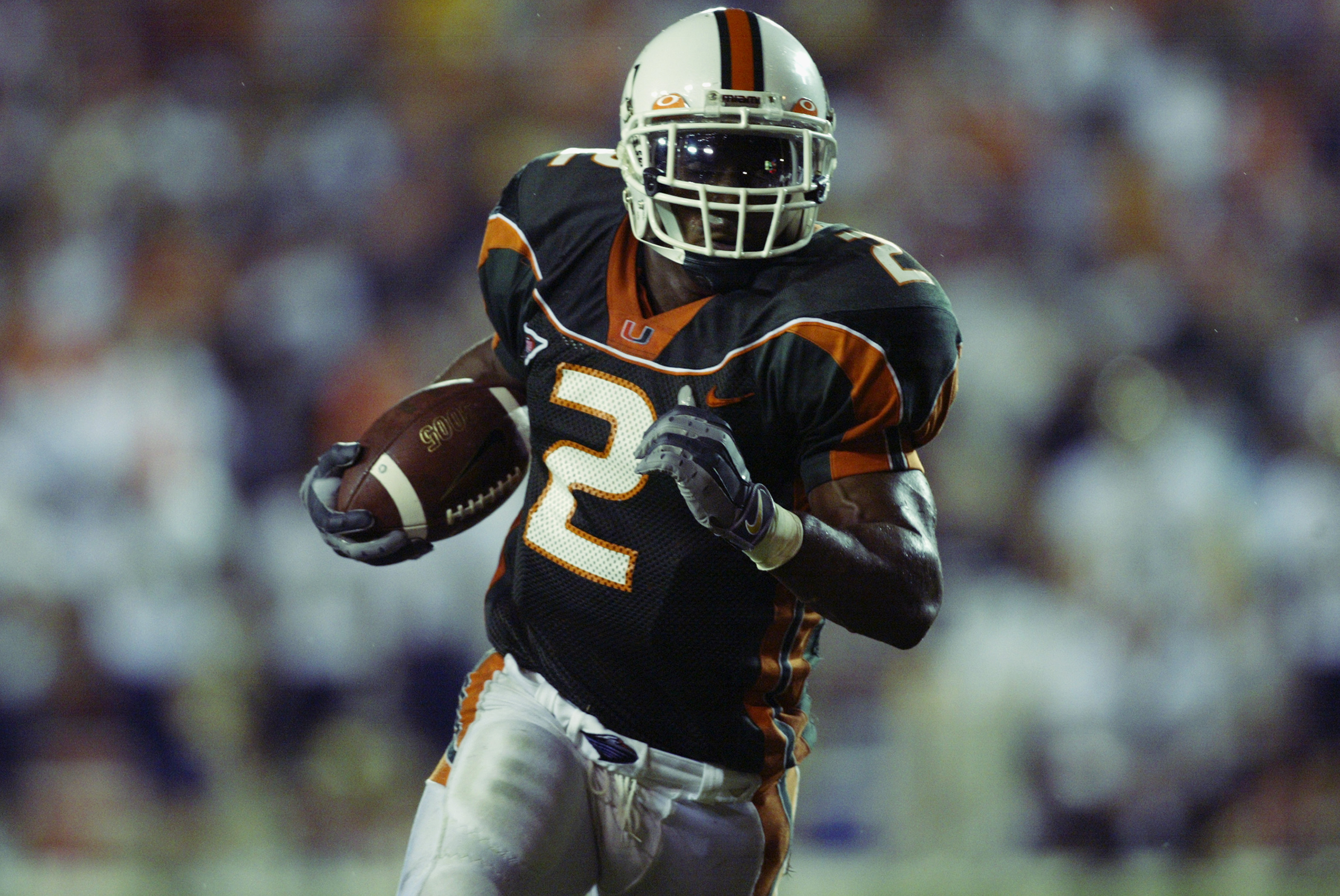 MIAMI, FL - NOVEMBER 21:  Running back Willis McGahee #2  of the University of Miami runs the ball against the University of Pittsburgh during the game at the Orange Bowl on November 21, 2002 in Miami, Florida.  (Photo by Andy Lyons/Getty Images)