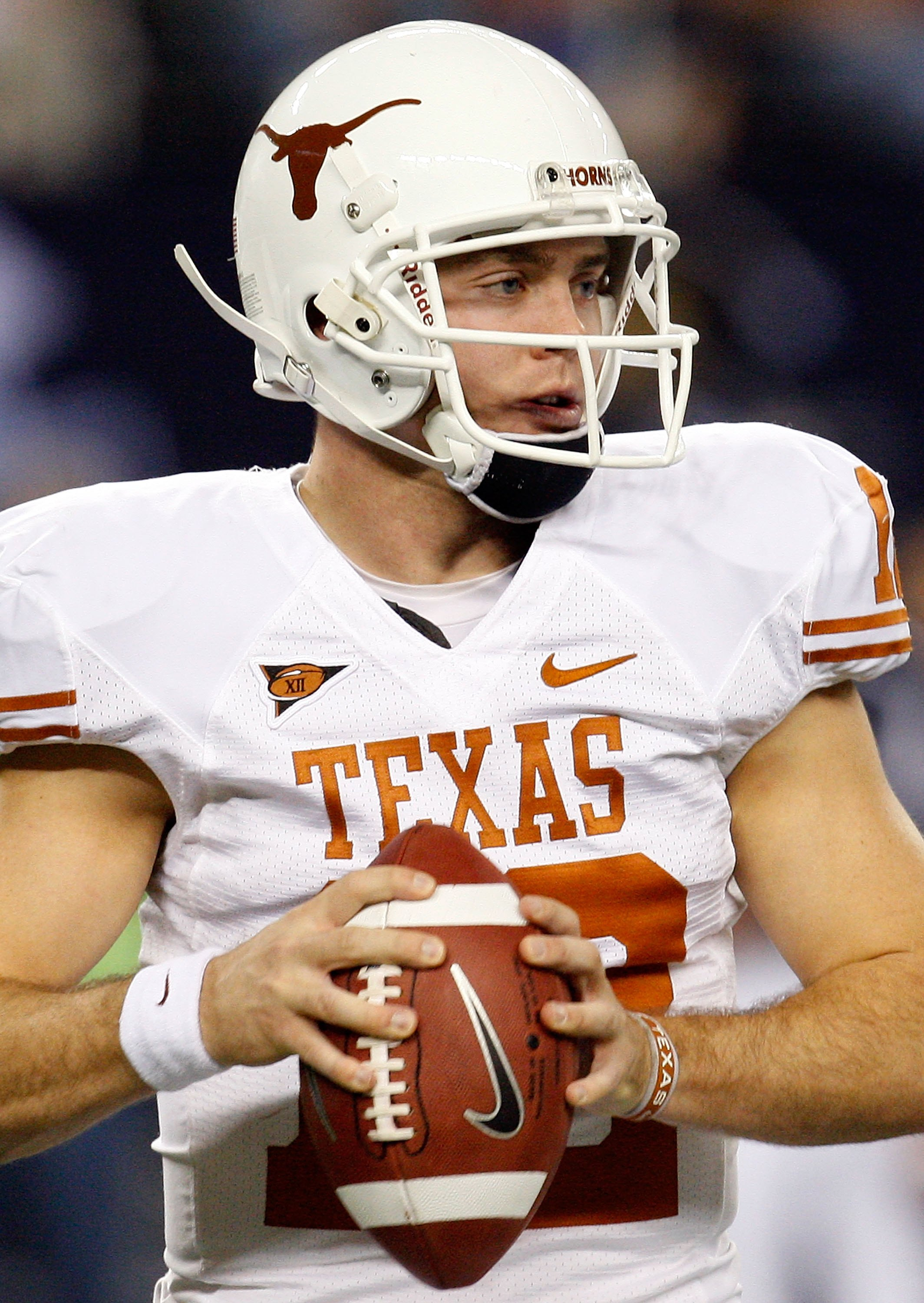 ARLINGTON, TX - DECEMBER 05:  Quarterback Colt McCoy #12 of the Texas Longhorns at Cowboys Stadium on December 5, 2009 in Arlington, Texas.  (Photo by Ronald Martinez/Getty Images)