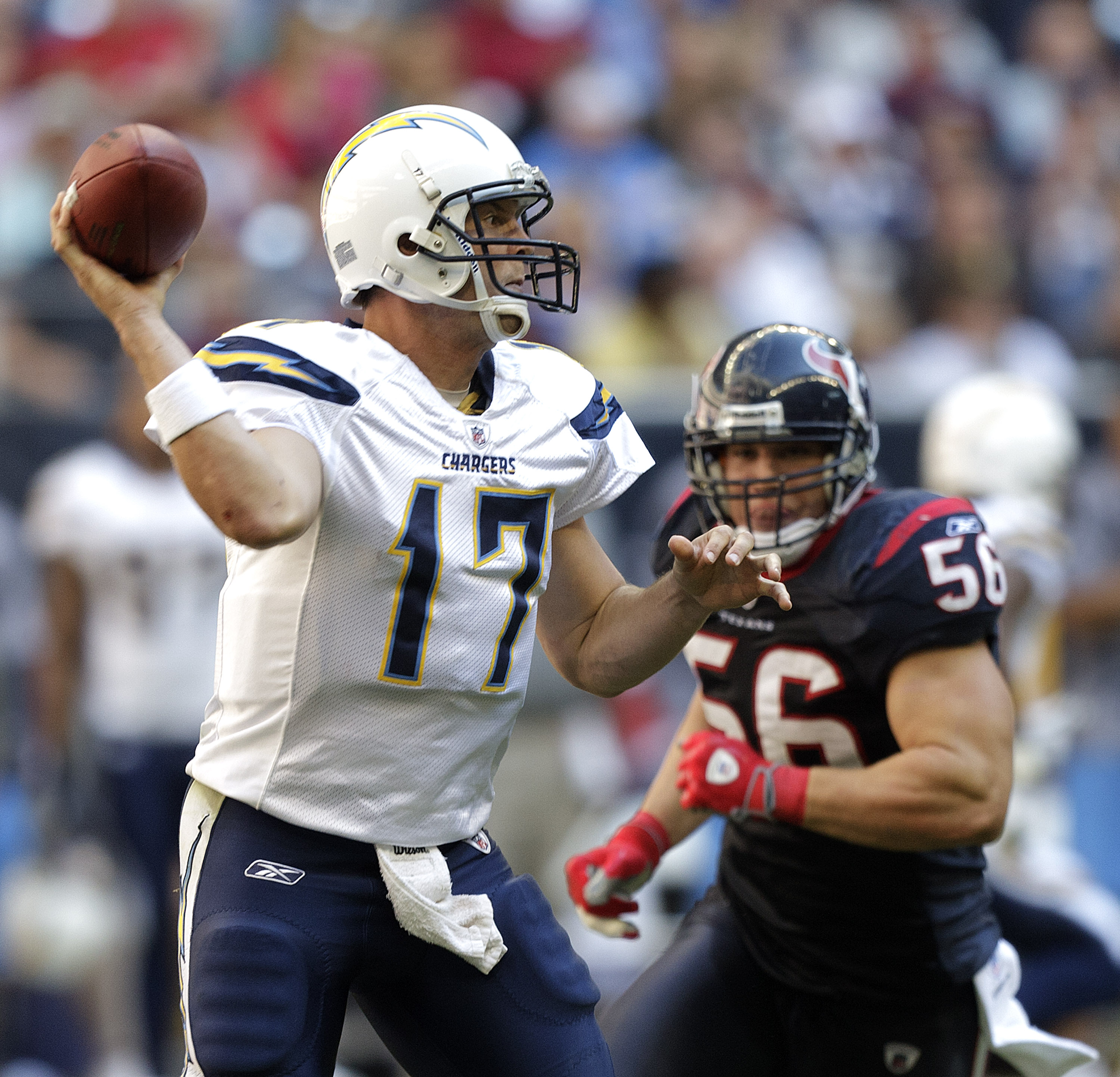 HOUSTON - NOVEMBER 07:  Quarterback Philip Rivers #17 of the San Diego Chargers throws downfield as linebacker Brian Cushing #56 of the Houston Texans applies pressure at Reliant Stadium on November 7, 2010 in Houston, Texas.  (Photo by Bob Levey/Getty Im