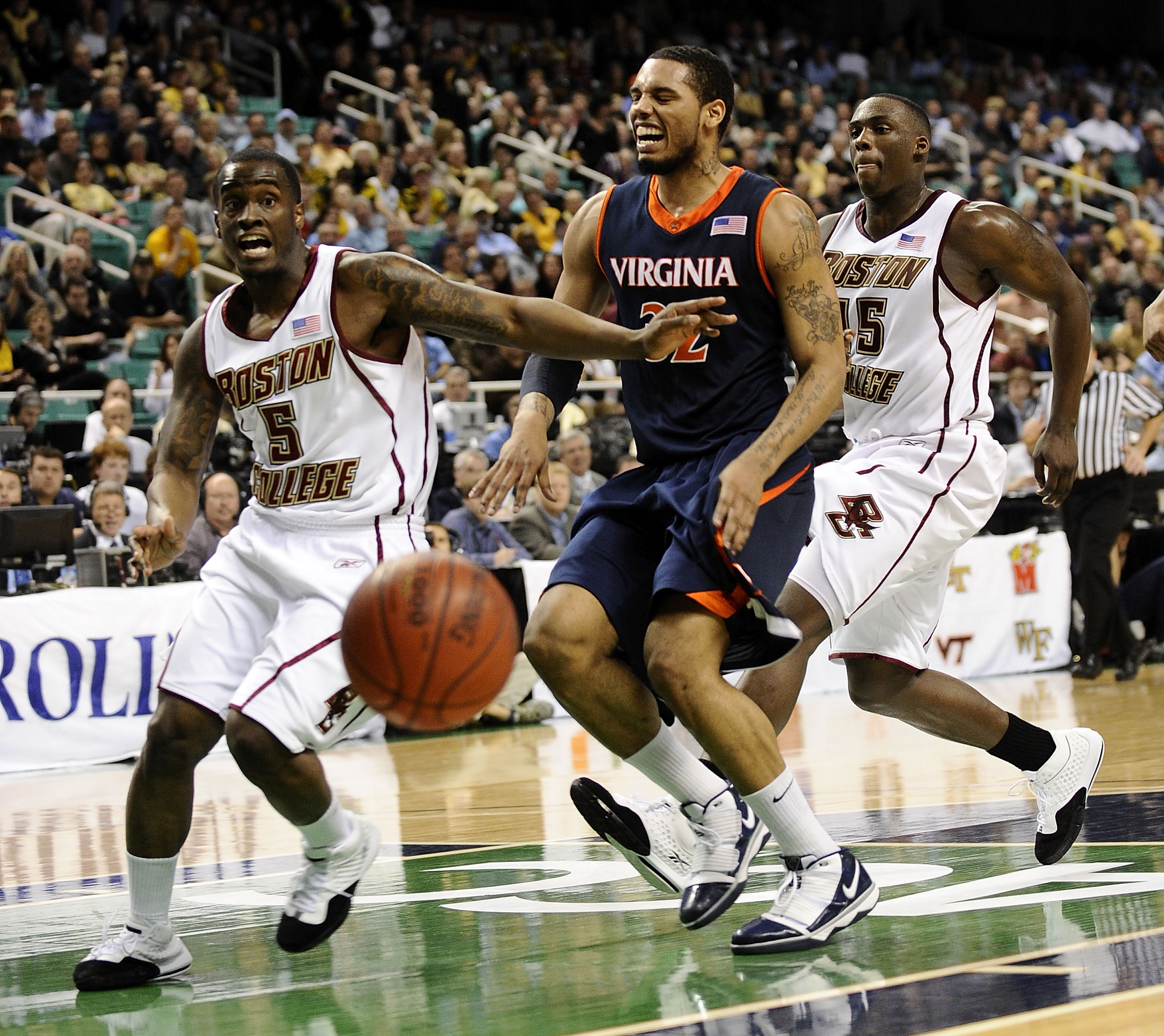 GREENSBORO, NC - MARCH 11:  Biko Paris #5 and Cortney Dunn #55 of the Boston College Eagles chase Mike Scott #32 of the University of Virginia Cavaliers in their first round game in the 2010 ACC Men's Basketball Tournament at the Greensboro Coliseum on Ma