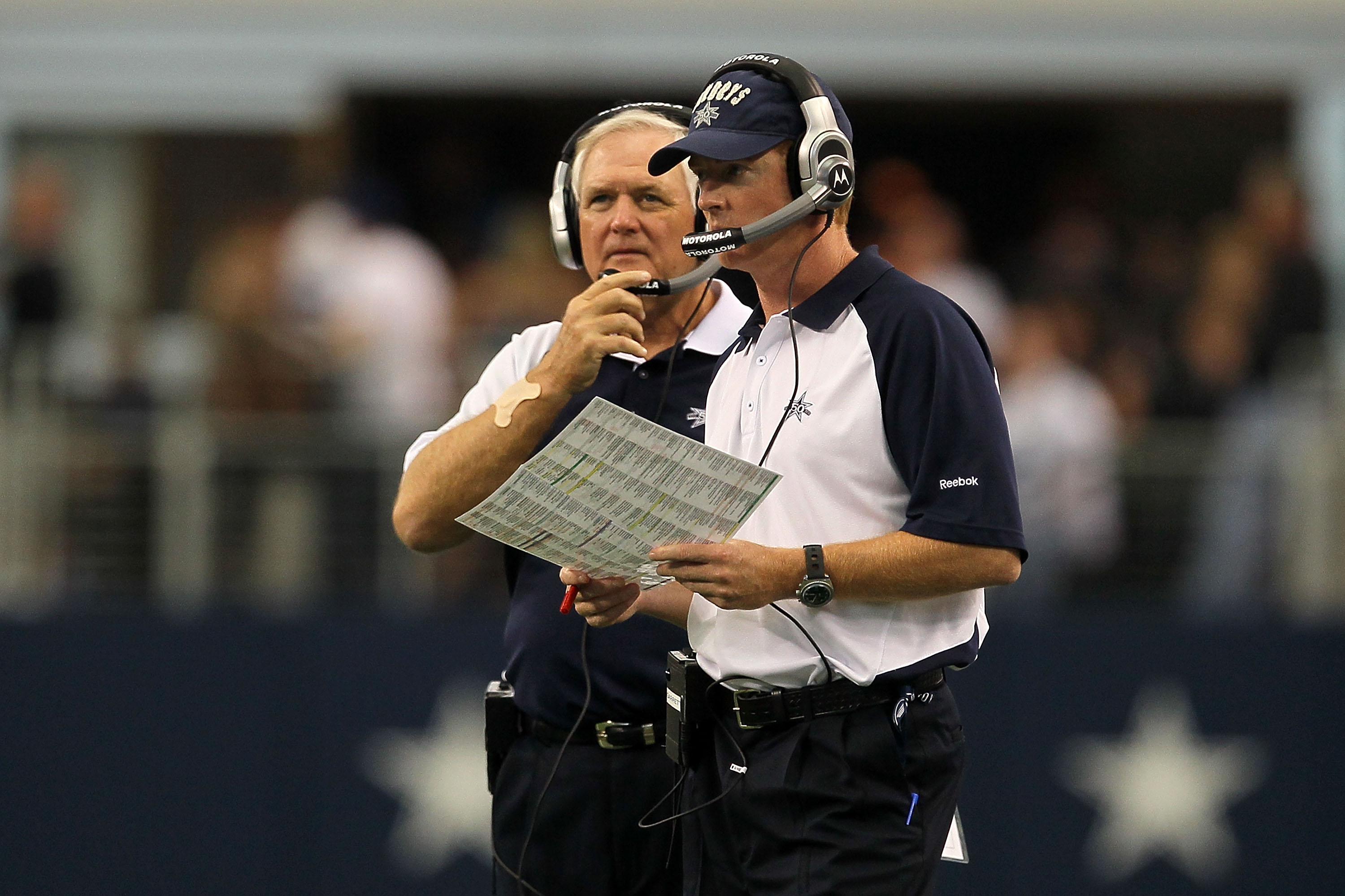 ARLINGTON, TX - OCTOBER 31:  (L-R) Head coach Wade Phillips and assistant head coach/offensive coordinator Jason Garrett of the Dallas Cowboys looks on against the Jacksonville Jaguars at Cowboys Stadium on October 31, 2010 in Arlington, Texas.  (Photo by