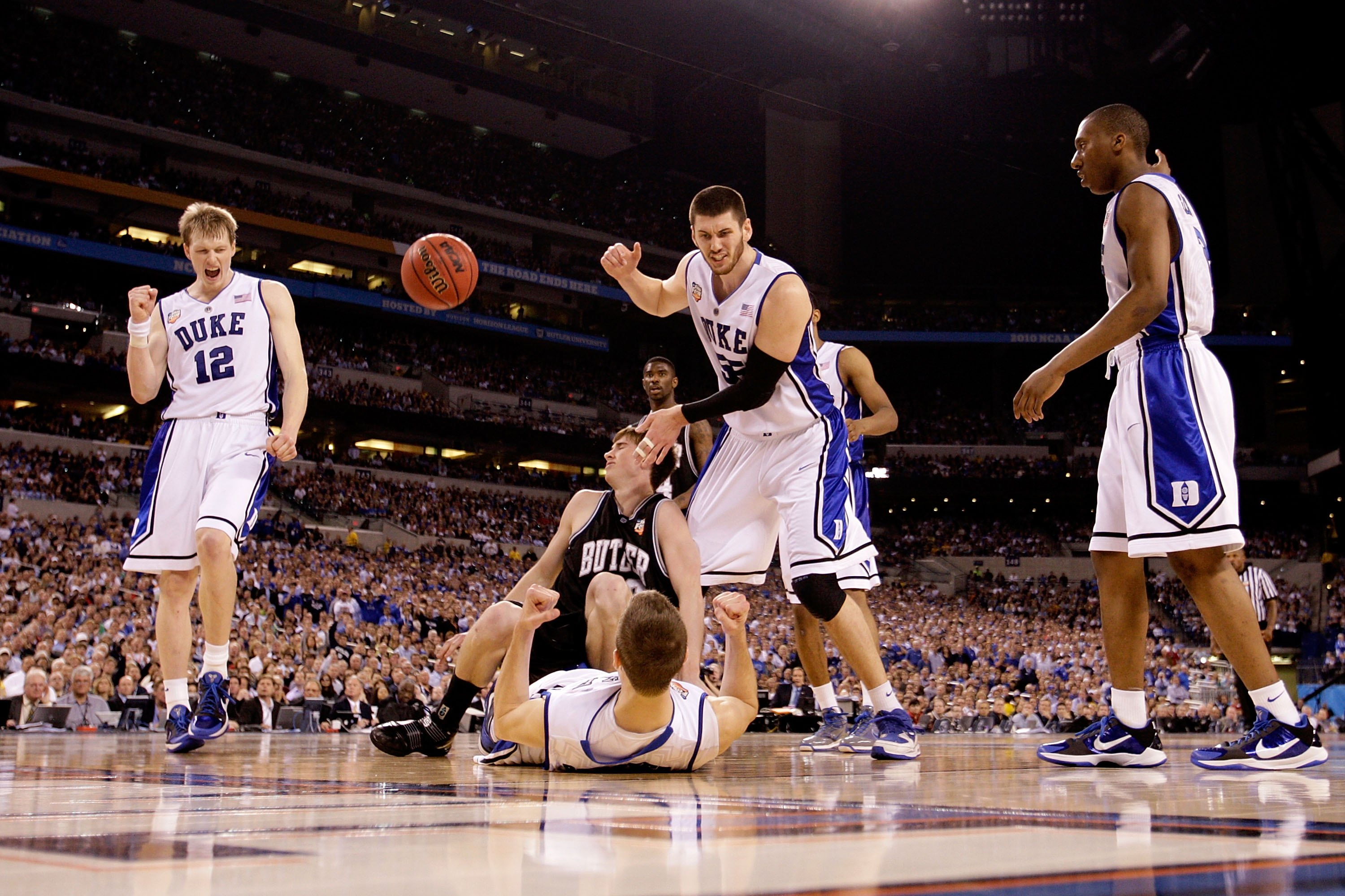 INDIANAPOLIS - APRIL 05:  (L-R) Kyle Singler #12, Jon Scheyer #30, Brian Zoubek #55 and Nolan Smith #2 of the Duke Blue Devils celebrate after Scheyer drew a charging foul against Gordon Hayward #20 of the Butler Bulldogs during the 2010 NCAA Division I M
