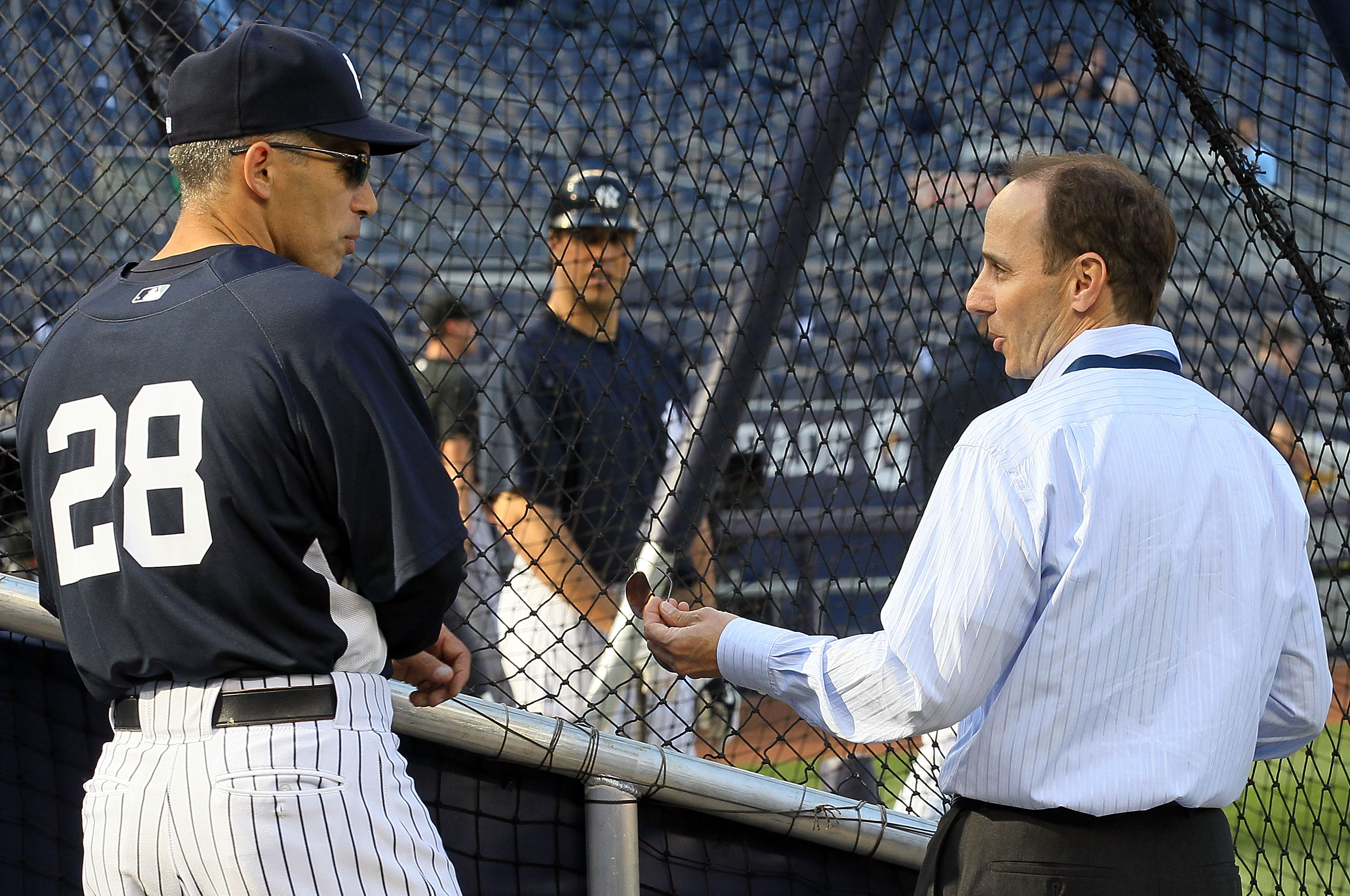 NEW YORK - APRIL 30:  Manager Joe Girardi of the New York Yankees talks with Yankee general manager Brian Cashman during batting practice prior to the game against the Chicago White Sox on April 30, 2010 at Yankee Stadium in the Bronx borough of New York