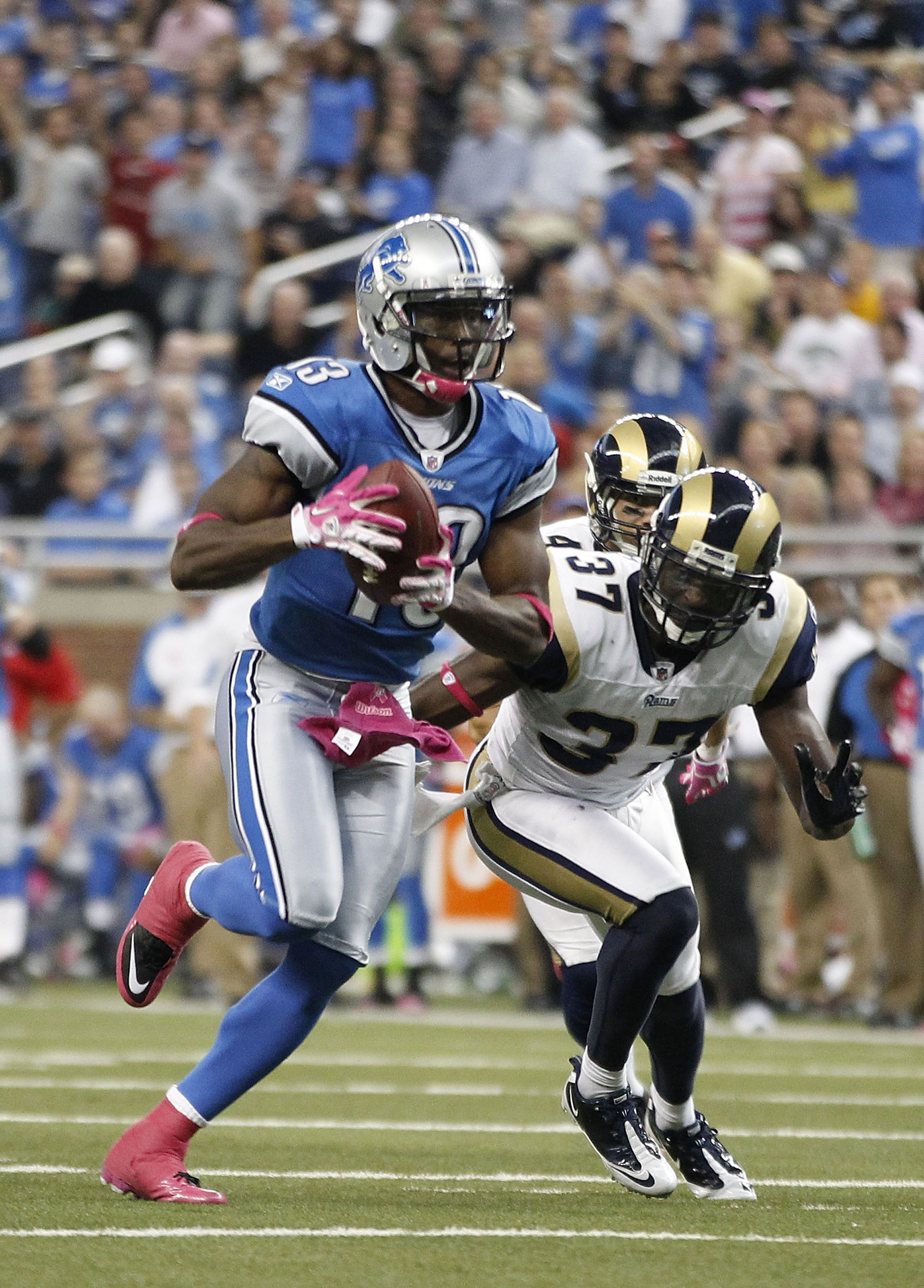 DETROIT - OCTOBER 10:  Nate Burleson #13 of the Detroit Lions scores a third quarter touchdown on a 21 yard pass from Shaun Hill #14 during the third quarter of the game against the St. Louis Rams during the second quarter of the game at Ford Field on Oct