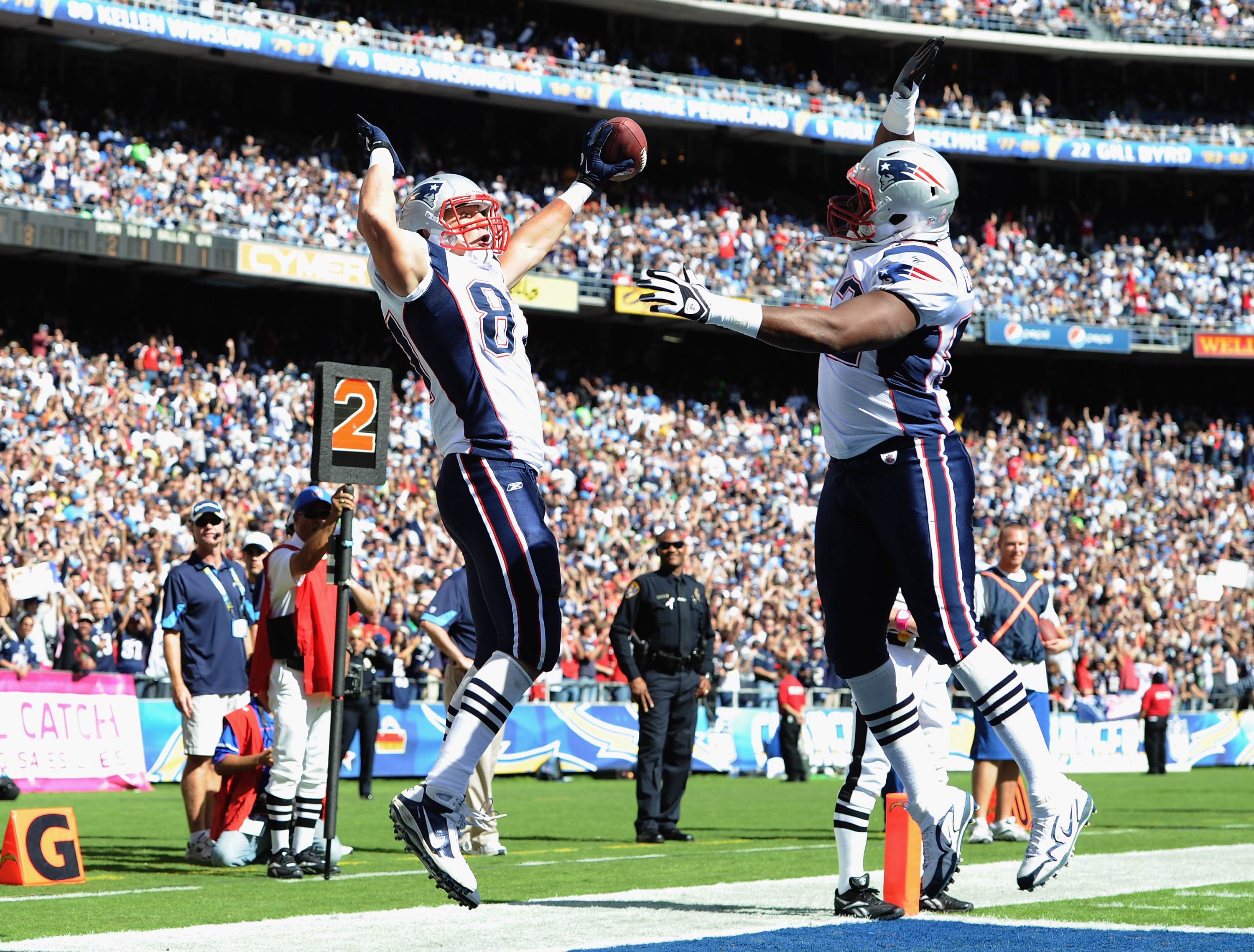 SAN DIEGO - OCTOBER 24:  Rob Gronkowski #87 of the New England Patriots celebrates his touchdown with Alge Crumpler #82 for a 7-3 lead over the San Diego Chargers during the first quarter at Qualcomm Stadium on October 24, 2010 in San Diego, California.