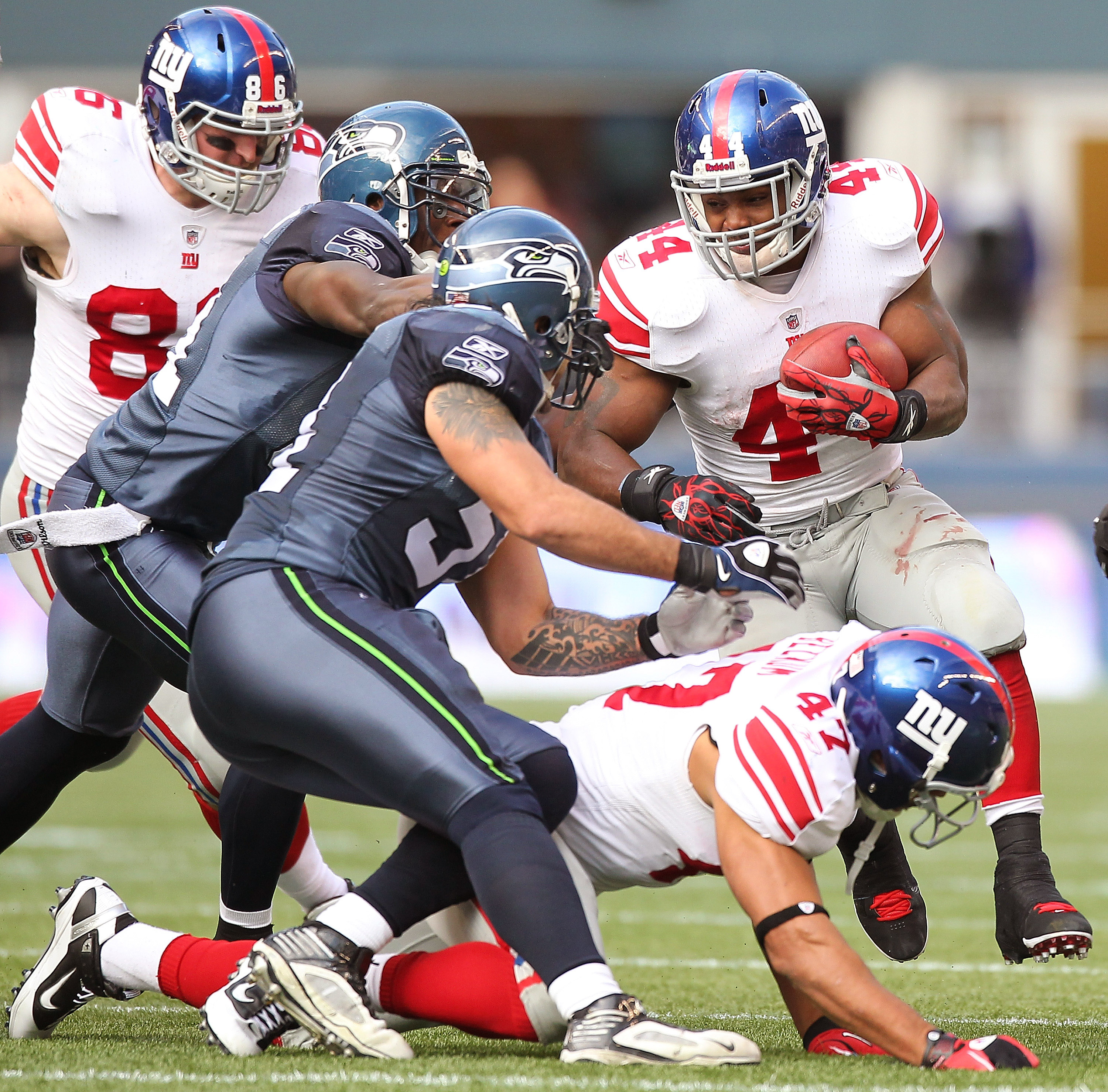 SEATTLE - NOVEMBER 07:  Running back Ahmad Bradshaw #44 of the New York Giants rushes against the Seattle Seahawks at Qwest Field on November 7, 2010 in Seattle, Washington. The Giants defeated the Seahawks 41-7. (Photo by Otto Greule Jr/Getty Images)