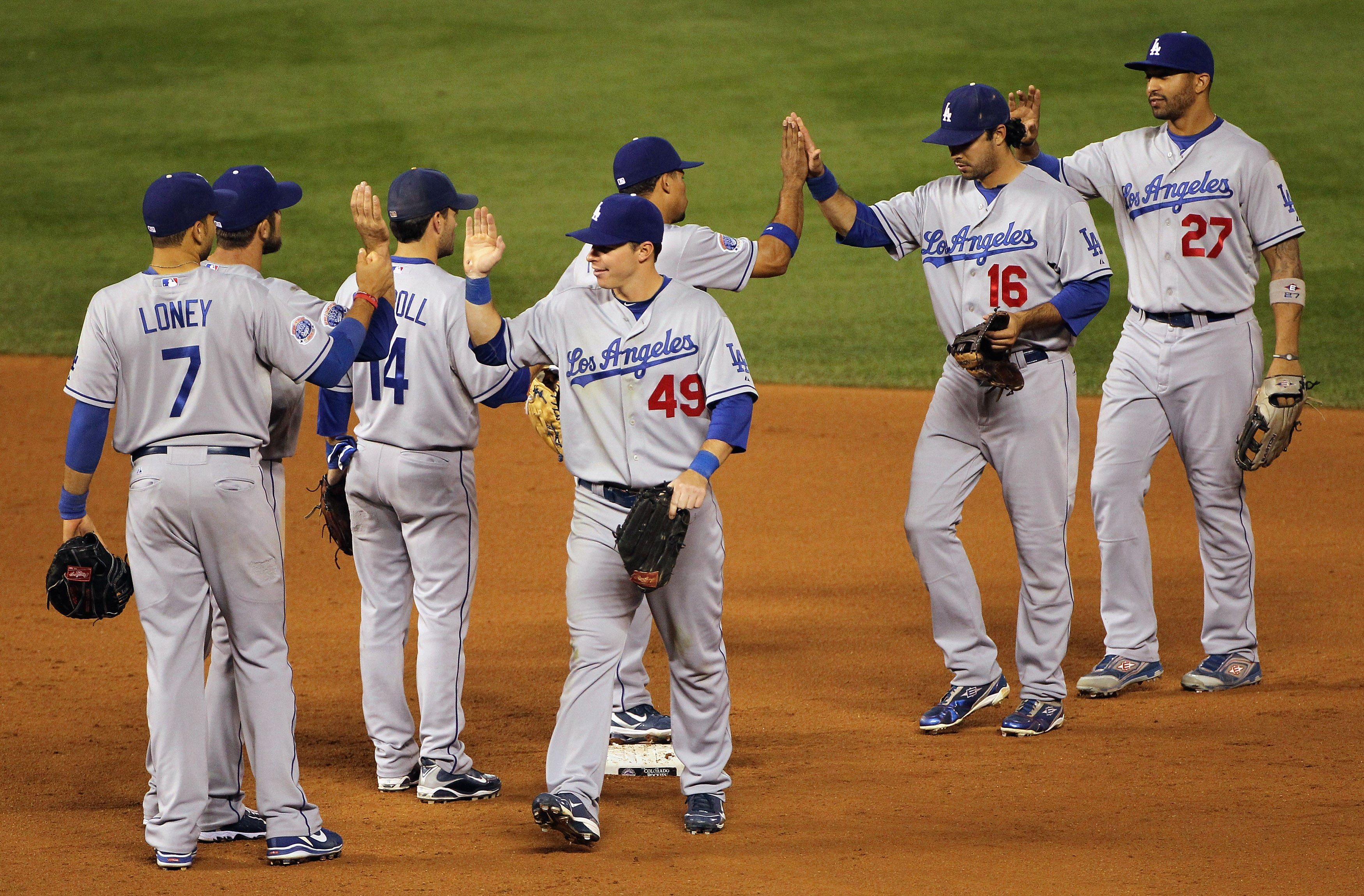 DENVER - SEPTEMBER 27:  The Los Angeles Dodgers celebrate their victory over the Colorado Rockies at Coors Field on September 25, 2010 in Denver, Colorado.The Dodgers defeated the Rockies 3-1.  (Photo by Doug Pensinger/Getty Images)
