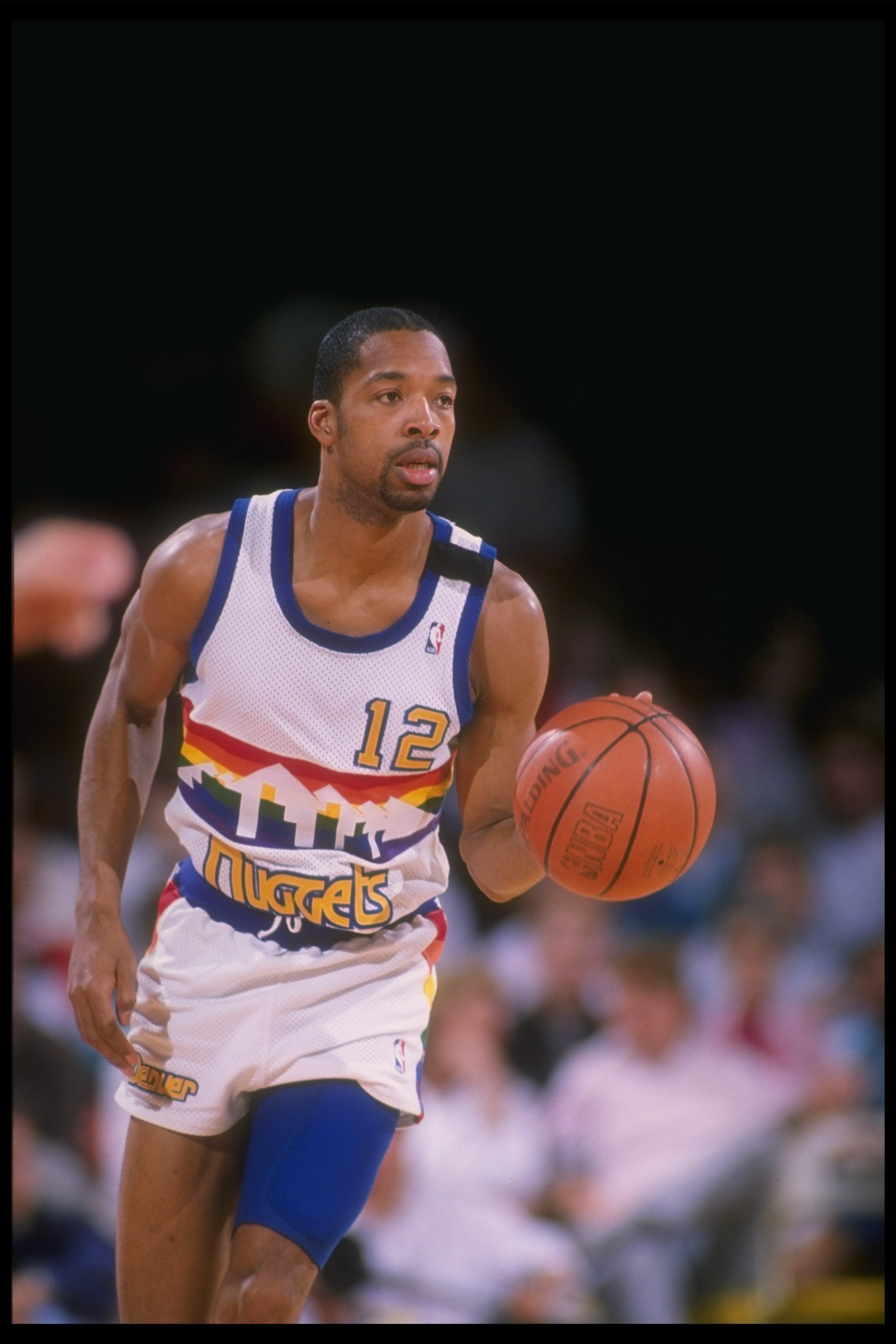 1989-1990:  Guard Fat Lever of the Denver Nuggets moves the ball during a game at the McNichols Sports Arena in Denver, Colorado. Mandatory Credit: Tim DeFrisco  /Allsport Mandatory Credit: Tim DeFrisco  /Allsport