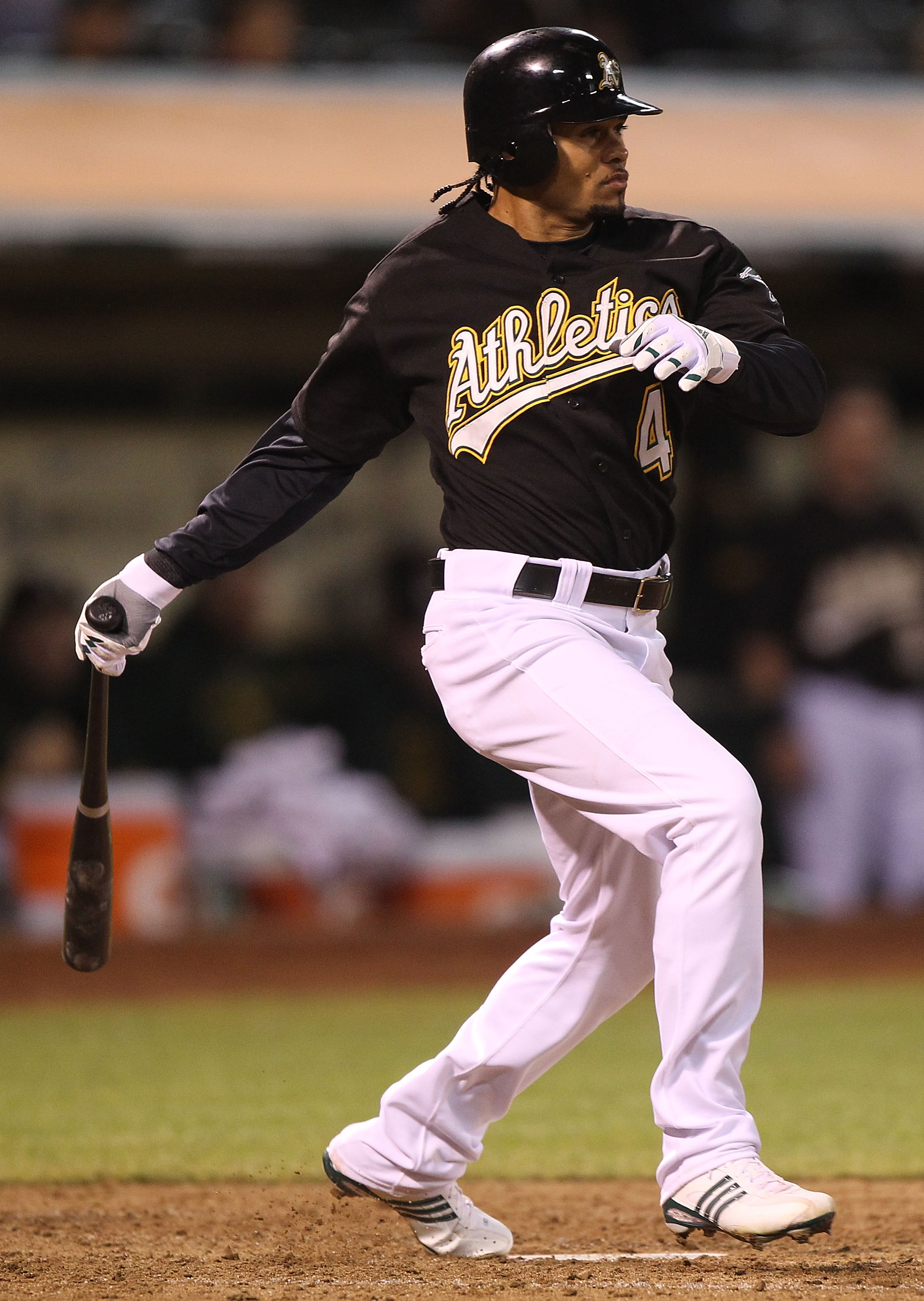 OAKLAND, CA - SEPTEMBER 08:  Coco Crisp #4 of the Oakland Athletics hits an RBI single in the sixth inning against the Seattle Mariners during a Major League Baseball game at the Oakland-Alameda County Coliseum on September 8, 2010 in Oakland, California.
