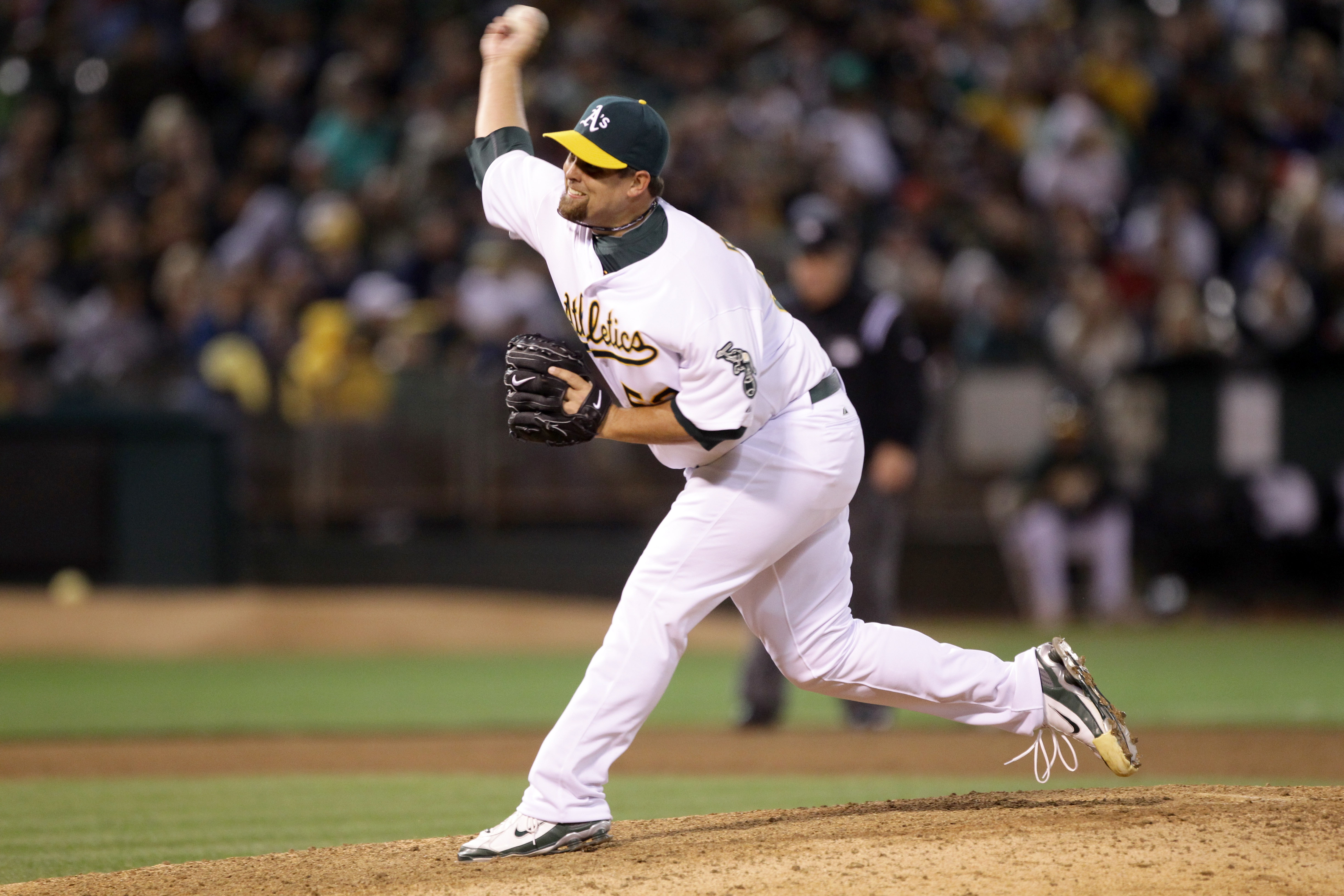 OAKLAND, CA - AUGUST 06:  Boof Bonser #52 of the Oakland Athletics pitches against the Texas Rangers at the Oakland-Alameda County Coliseum on August 6, 2010 in Oakland, California.  (Photo by Ezra Shaw/Getty Images)