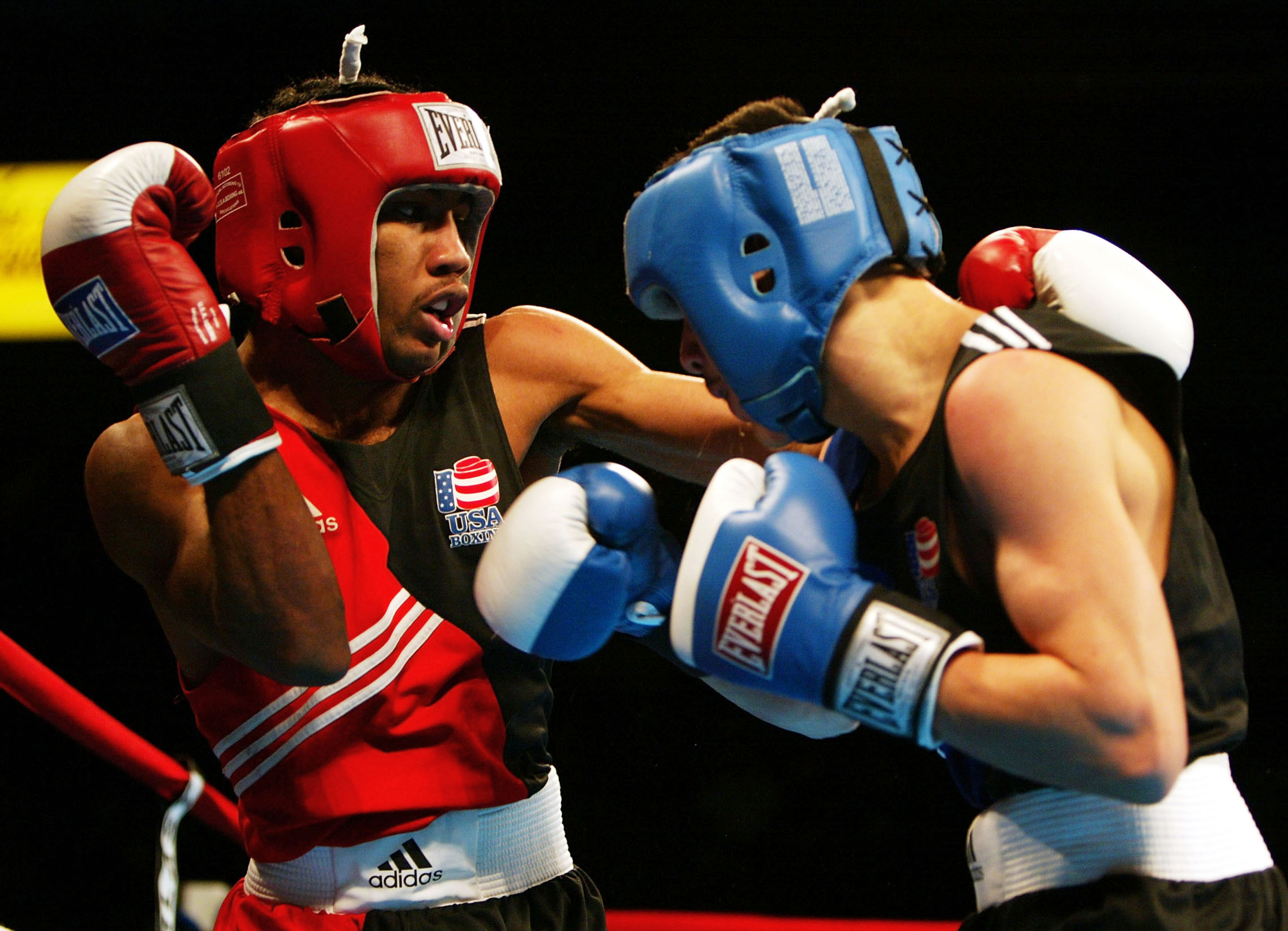 CLEVELAND, OH - FEBRUARY 27:  Mickey Bey Jr. of Cleveland, Ohio (L) lands a punch during his featherweight (125lbs) match against Brandon Rios of Garden City, Kansas during the 2004 Olympic Box-Offs at the Cleveland Convocation Center February 27, 2004 in