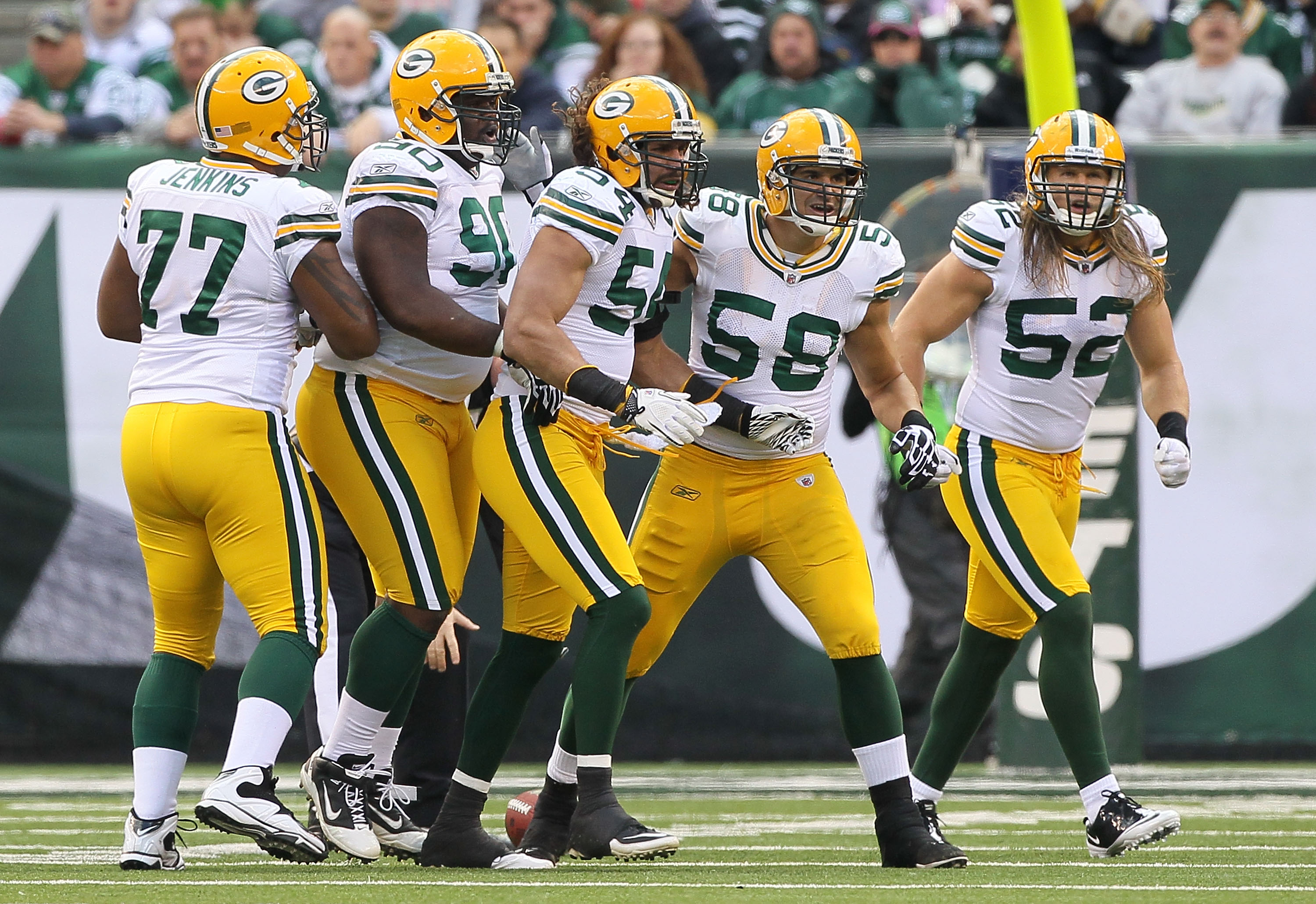 EAST RUTHERFORD, NJ - OCTOBER 31:  The defense of the Green Bay Packers celebrate a play against the New York Jets on October 31, 2010 at the New Meadowlands Stadium in East Rutherford, New Jersey.  (Photo by Jim McIsaac/Getty Images)