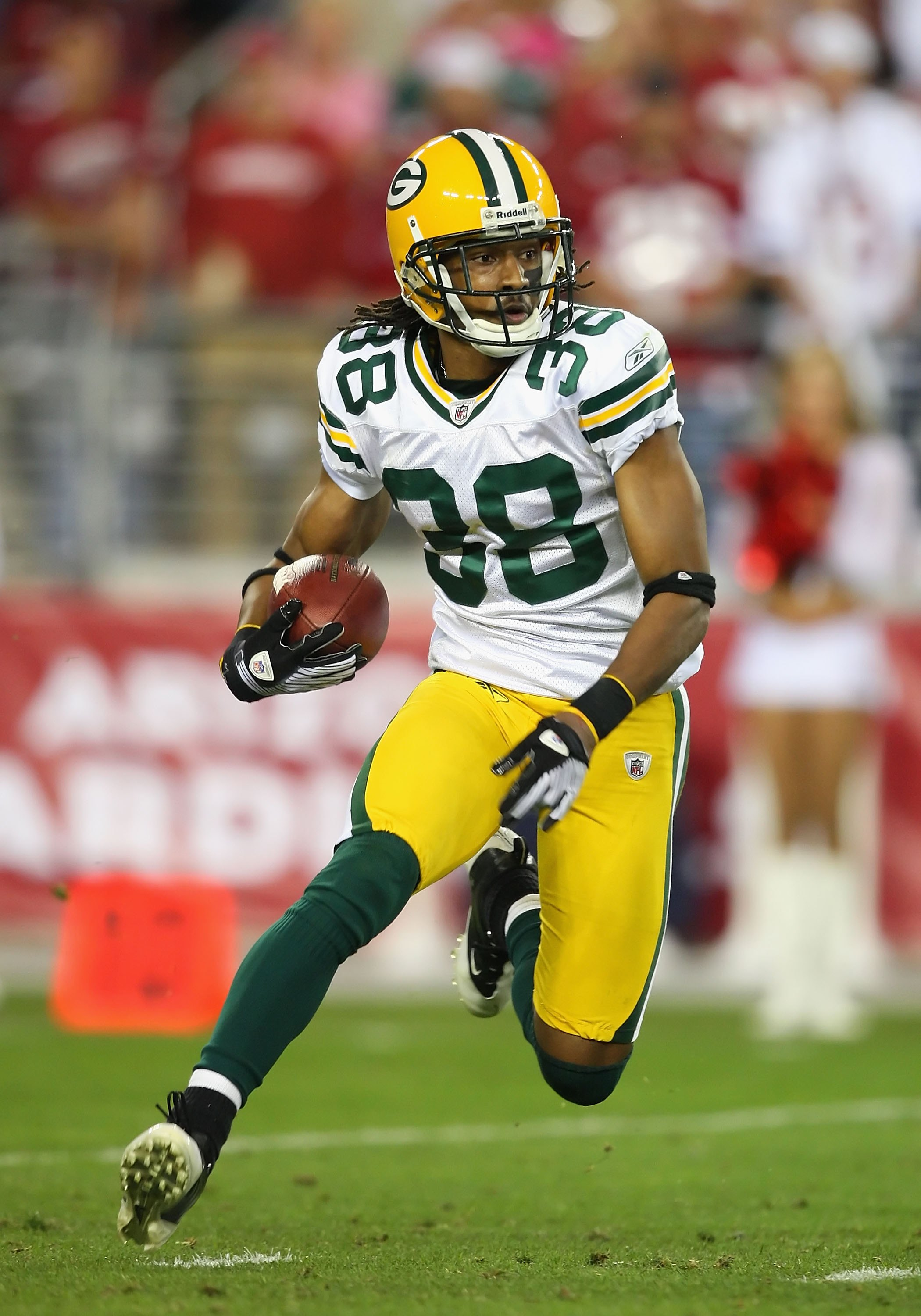 GLENDALE, AZ - JANUARY 10:  Tramon Williams #38 of the Green Bay Packers returns a kick off during the 2010 NFC wild-card playoff game against the Arizona Cardinals at the Universtity of Phoenix Stadium on January 10, 2010 in Glendale, Arizona.  The Cardi