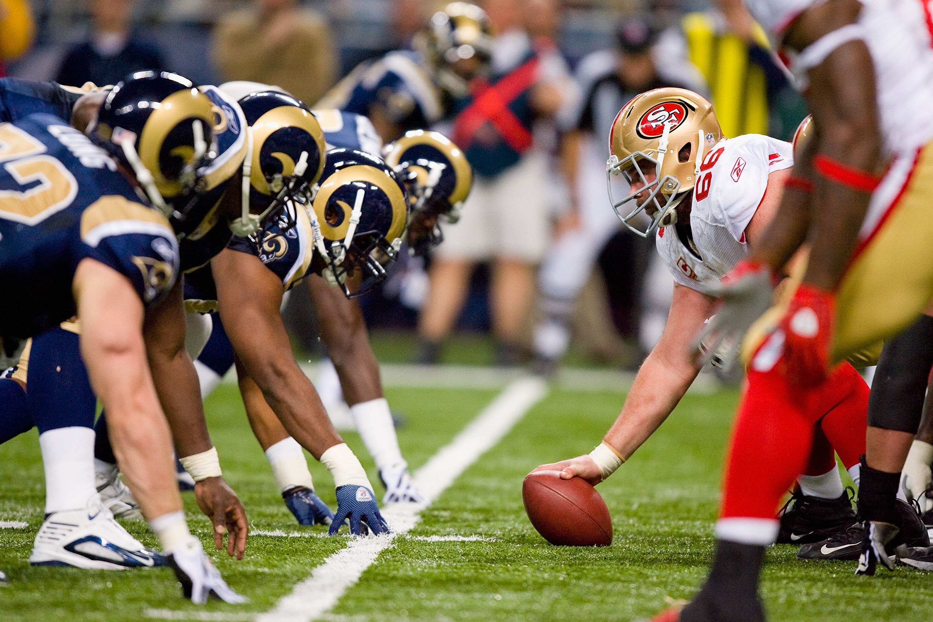 ST. LOUIS - JANUARY 3:  Center Eric Heitmann #66 of the San Francisco 49ers gets ready to hike the ball during the game against the St. Louis Rams at the Edward Jones Dome on January 3, 2010 in St. Louis, Missouri.  The 49ers beat the Rams 28-6.  (Photo b