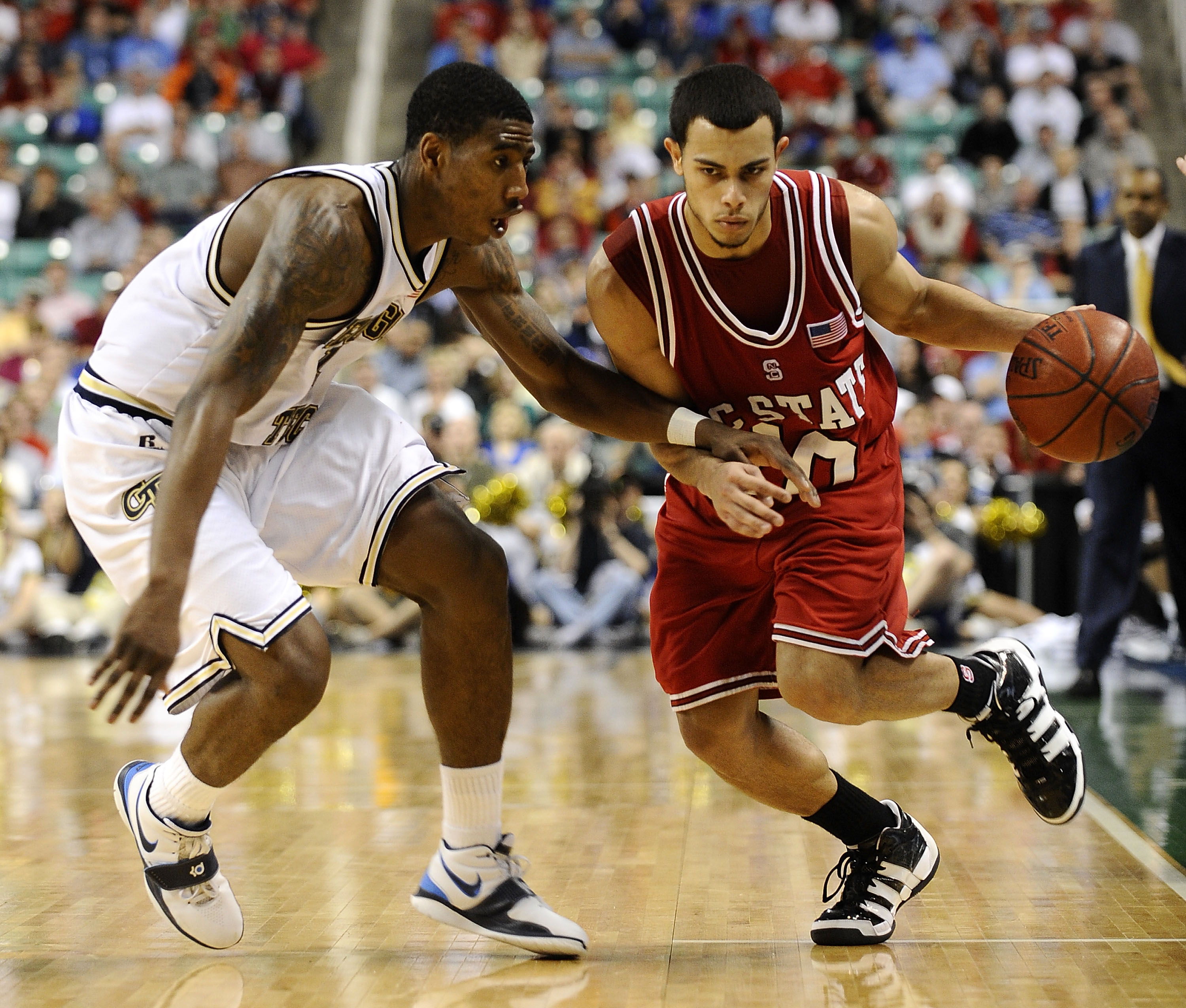 GREENSBORO, NC - MARCH 13:  Iman Shumpert #1 of the Georgia Tech Yellow Jackets guards Javier Gonzalez #10 of the North Carolina State Wolfpack in their semifinal game in the 2010 ACC Men's Basketball Tournament at the Greensboro Coliseum on on March 13,