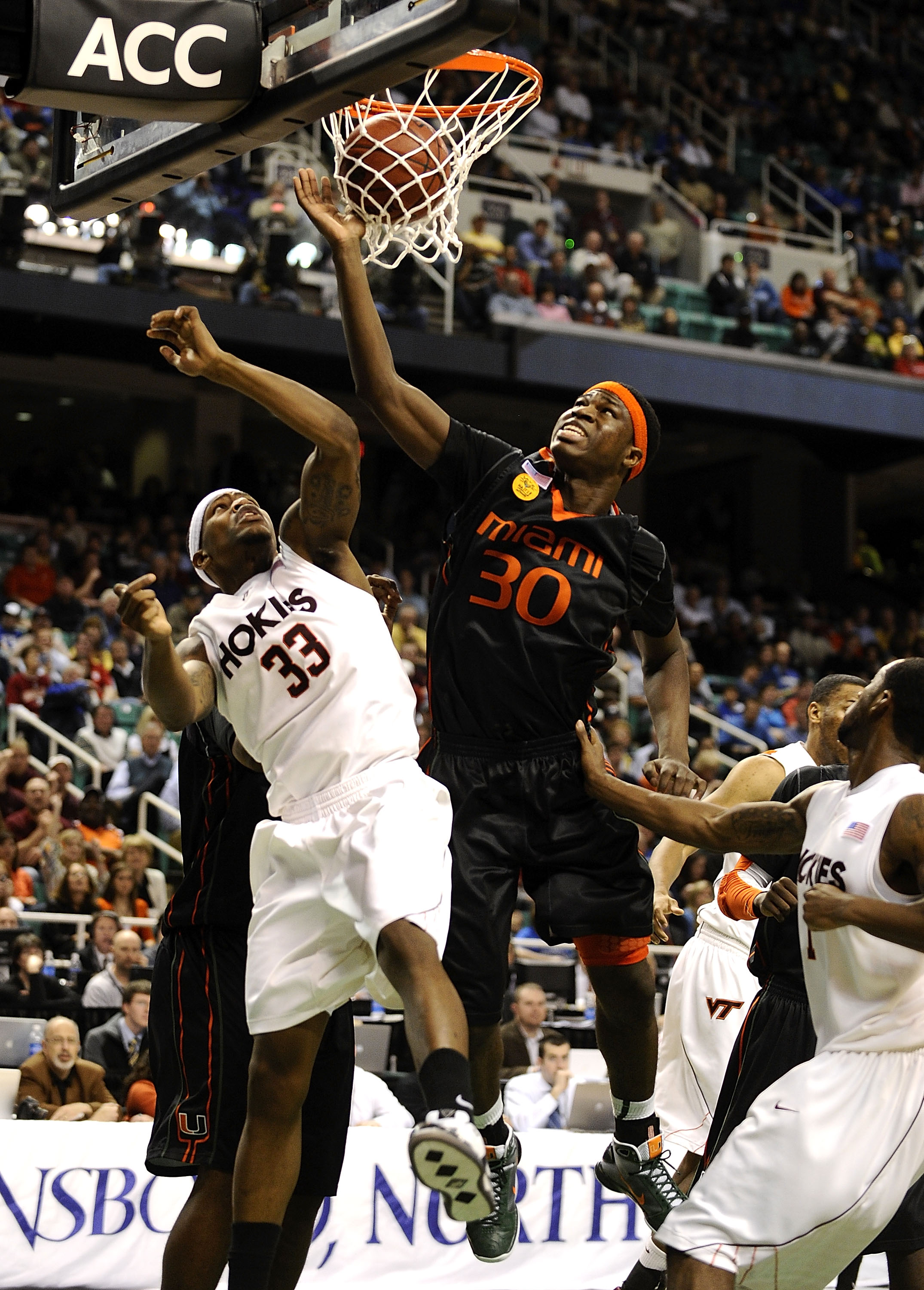 GREENSBORO, NC - MARCH 12:  JT Thompson #33 of the Virginia Tech Hokies defends against Adrian Thomas #30 of the University of Miami Hurricanes in their quarterfinal game in the 2010 ACC Men's Basketball Tournament at the Greensboro Coliseum on March 12,