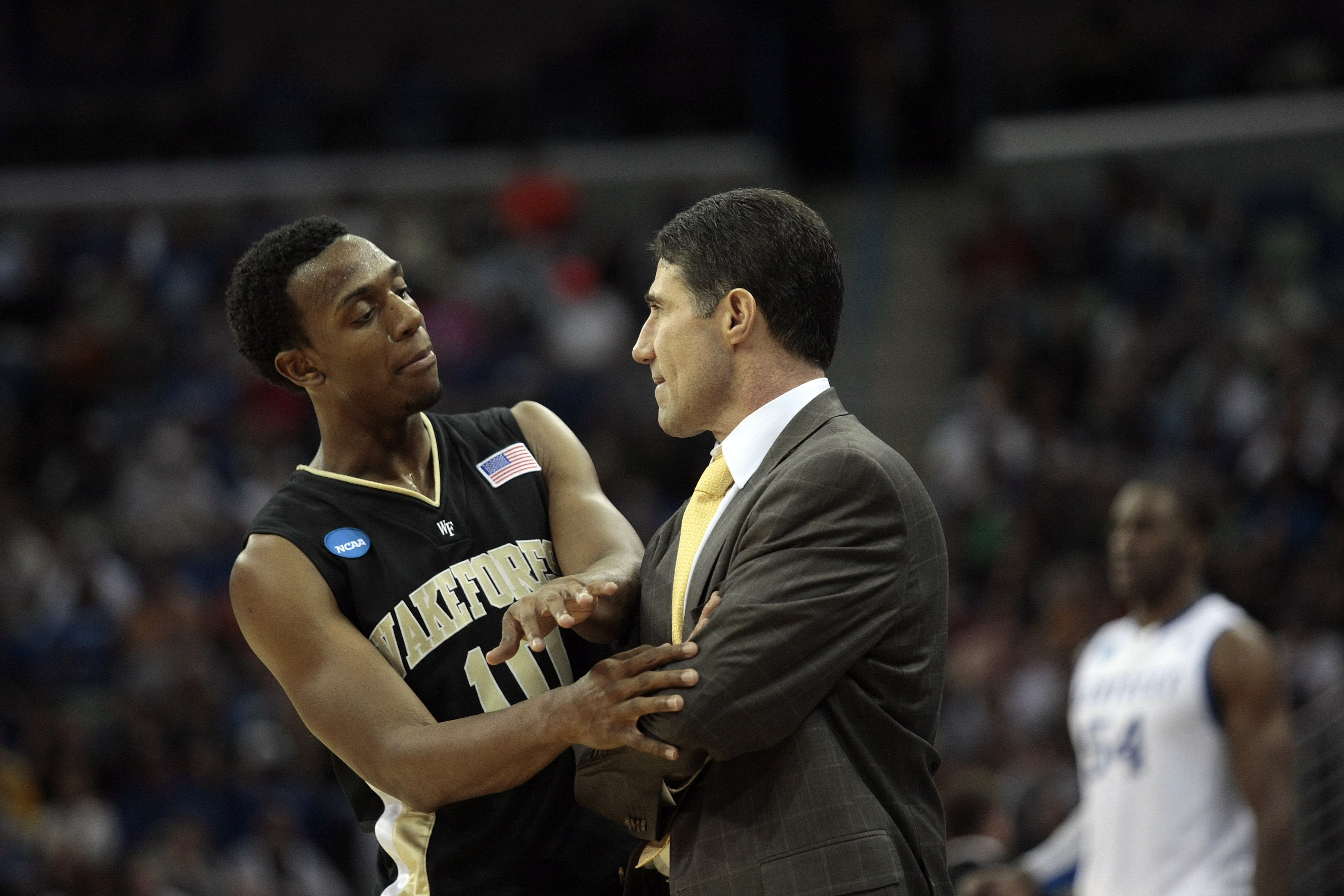NEW ORLEANS - MARCH 20:  Ishmael Smith #10 talks with coach Dino Gaudio of the Wake Forest Deacon Demons during the second round of the 2010 NCAA mens basketball tournament at the New Orleans Arena on March 20, 2010 in New Orleans, Louisiana.  (Photo by D