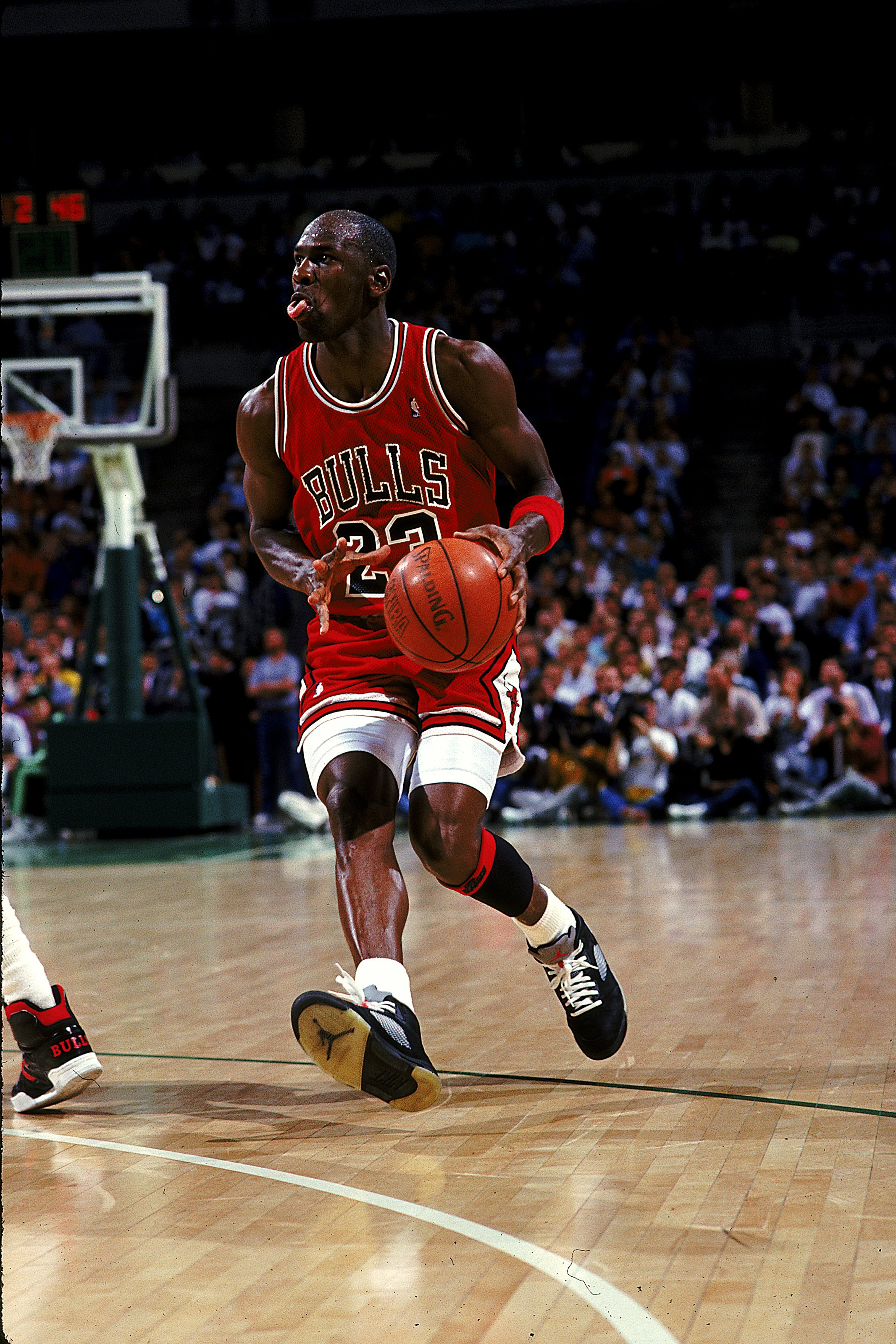 1990:  Michael Jordan #23 of the Chicago Bulls moves with the ball during the game.   Mandatory Credit: Allsport  /Allsport