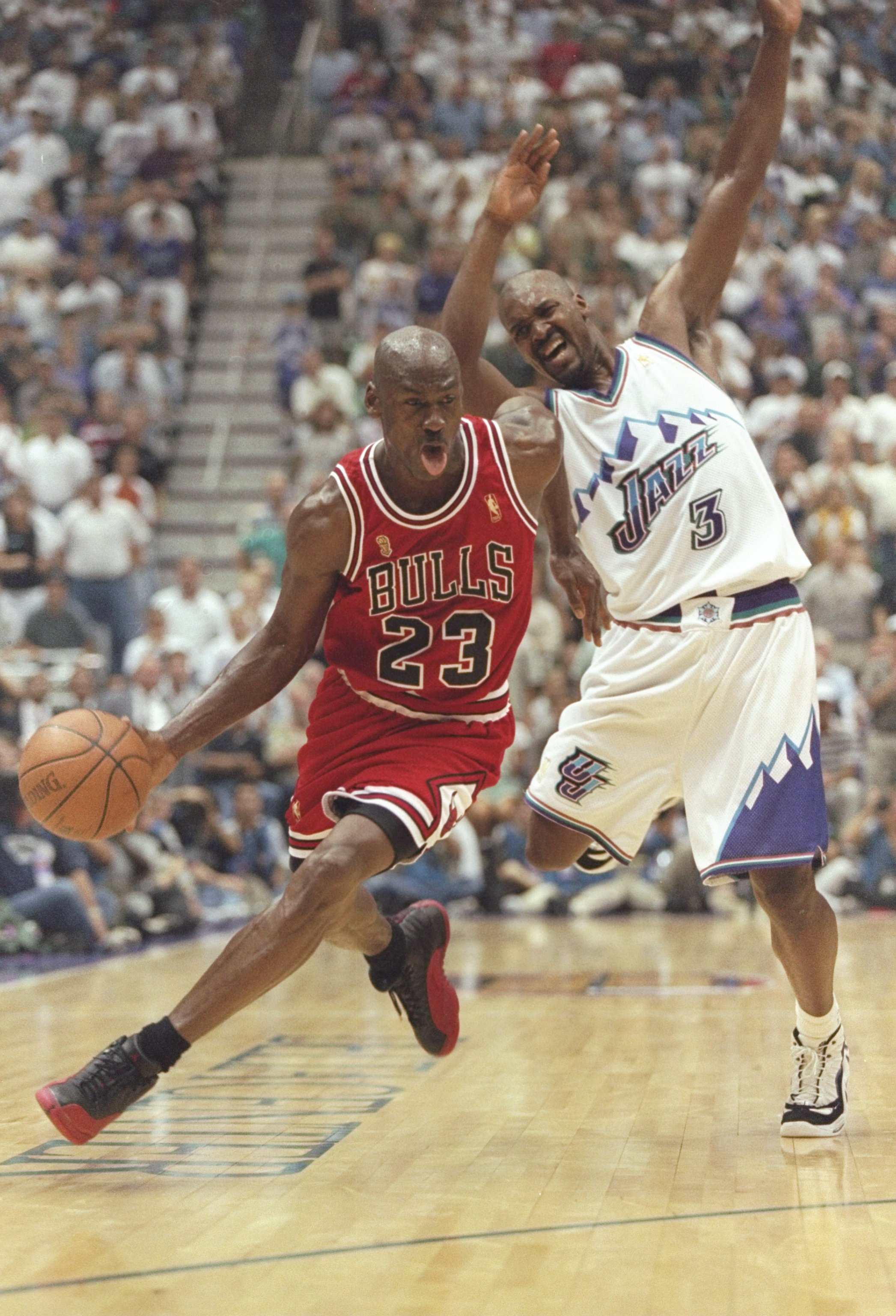 11 Jun 1997: Michael Jordan of the Chicago Bulls drives around Bryon Russell #3 of the Jazz during the Bulls 90-88 win over the Utah Jazz in Game 5 of the NBA Finals at the Delta Center in Salt Lake City, Utah.