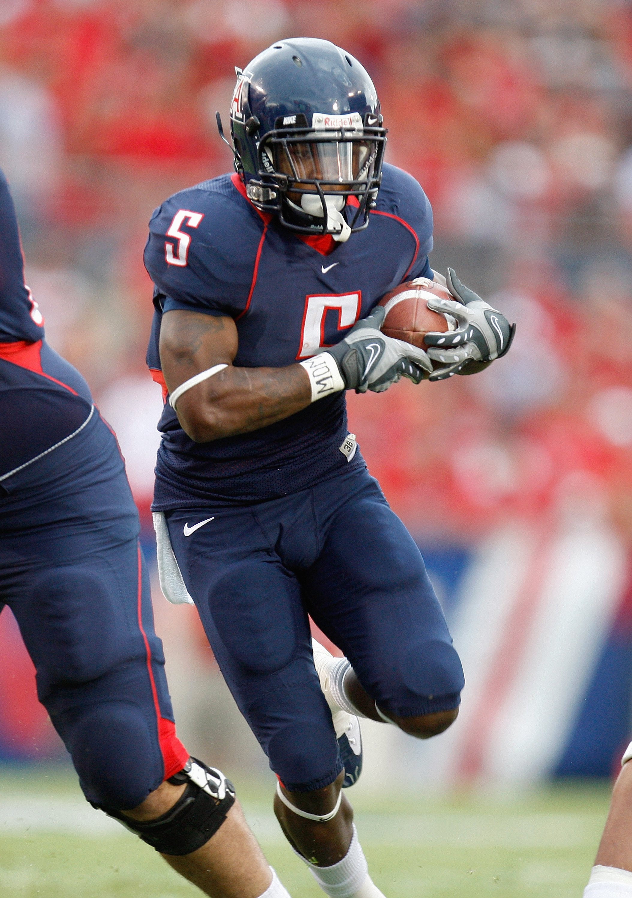TUSCON - OCTOBER 4:  Nicolas Grigsby #5 of the Arizona Wildcats carries the ball during the game against the Washington Huskies on October 4, 2008 at Arizona Stadium in Tucson, Arizona. (Photo by: Gregory Shamus/Getty Images)