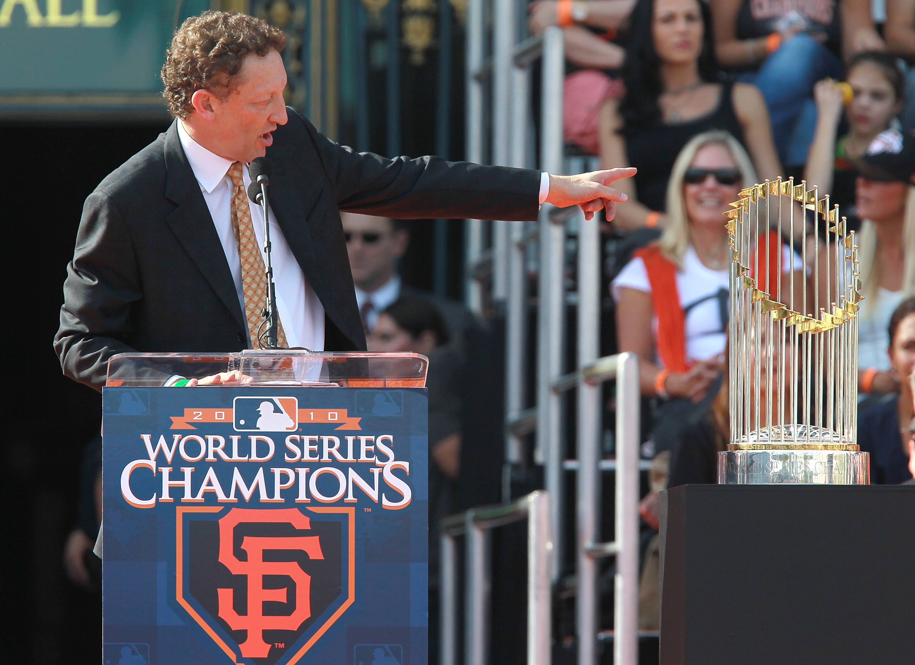 """Giants President Larry Baer points to the World Series trophy and says, """"This is mine."""""""