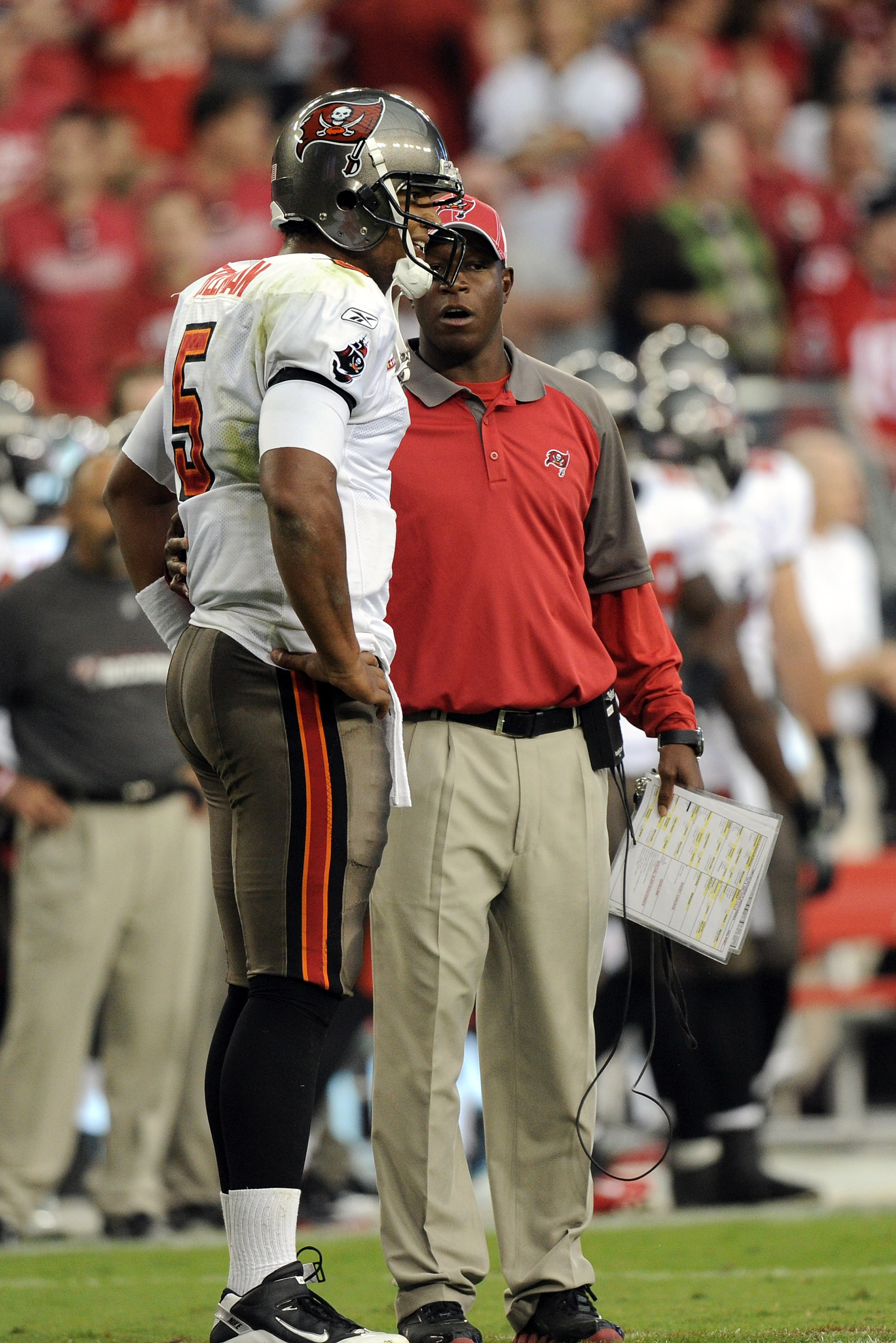 GLENDALE, AZ - OCTOBER 31:  Josh Freeman #5 of the Tampa Bay Buccaneers speaks to Head Coach Raheem Morris during a timeout against the Arizona Cardinals at University of Phoenix Stadium on October 31, 2010 in Glendale, Arizona.  (Photo by Harry How/Getty