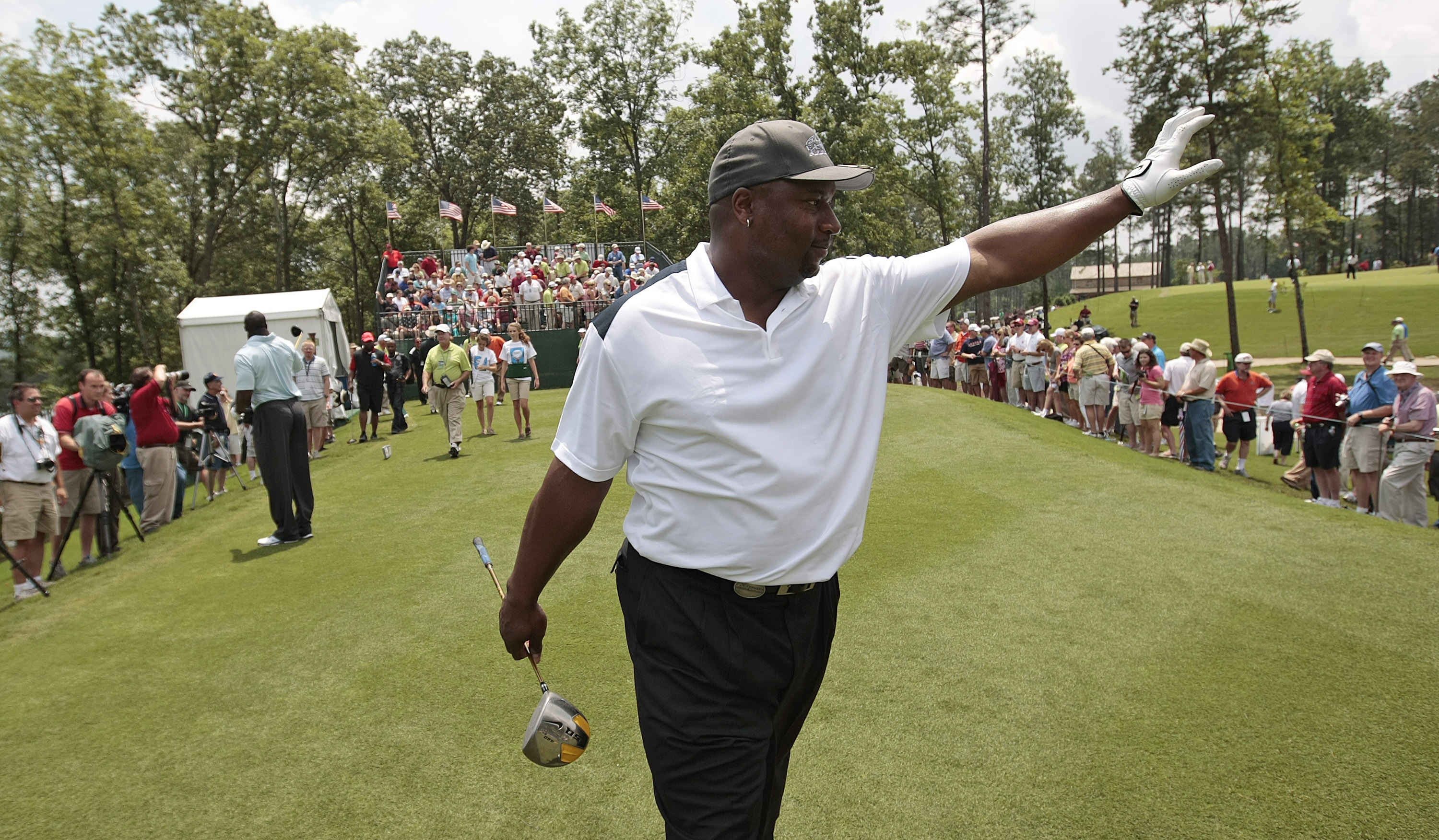 BIRMINGHAM, AL - MAY 14: Former NFL football star Bo Jackson waves to fans as he walks off the first tee during the Thursday Pro-AM of the Regions Charity Classic at the Robert Trent Jones Golf Trail at Ross Bridge on May 14, 2009  in Birmingham, Alabama.