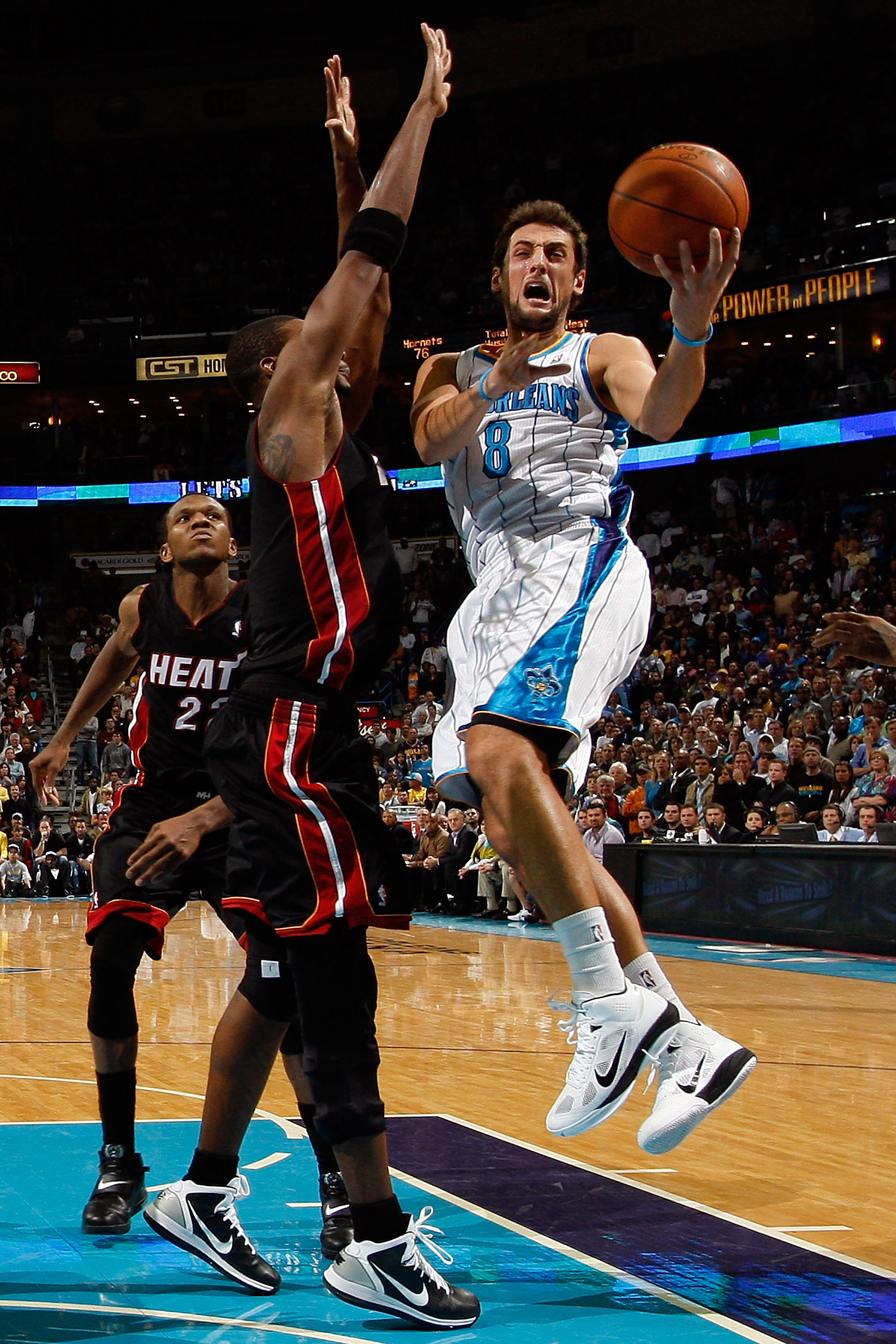 NEW ORLEANS - NOVEMBER 05:  Marco Belinelli #8 of the New Orleans Hornets shoots the ball over Chris Bosh #1 of the Miami Heat at the New Orleans Arena on November 5, 2010 in New Orleans, Louisiana.  The Hornets defeated the Heat 96-93.  NOTE TO USER: Use