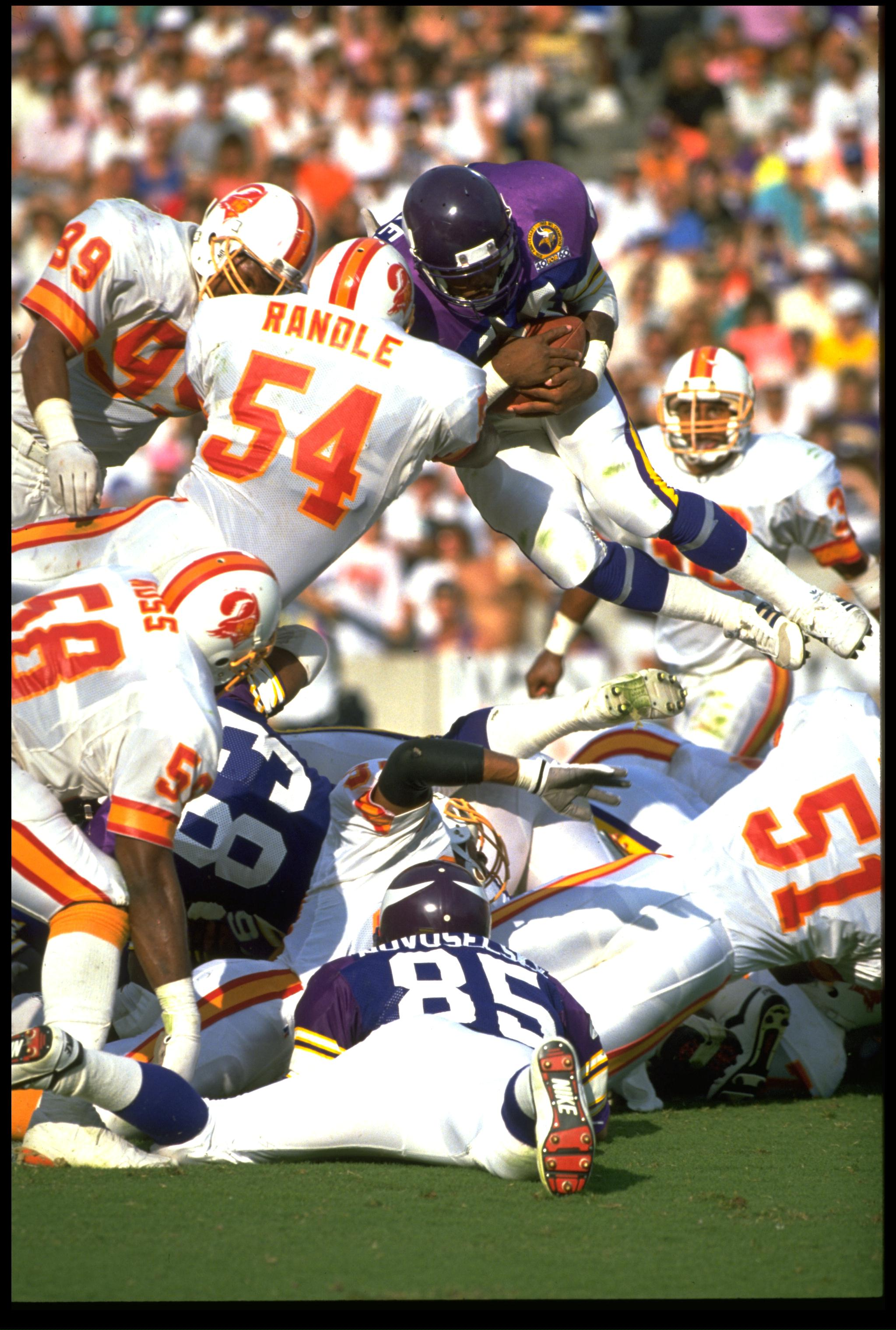 12 NOV 1989:  MINNESOTA VIKINGS RUNNING BACK HERSCHEL WALKER LEAPS FOR THE ENDZONE DURING THE VIKINGS 24-10 WIN OVER THE TAMPA BAY BUCCANEERS AT TAMPA STADIUM IN TAMPA BAY, FLORIDA.  MANDATORY CREDIT:  SCOTT HALLERAN /ALLSPORT
