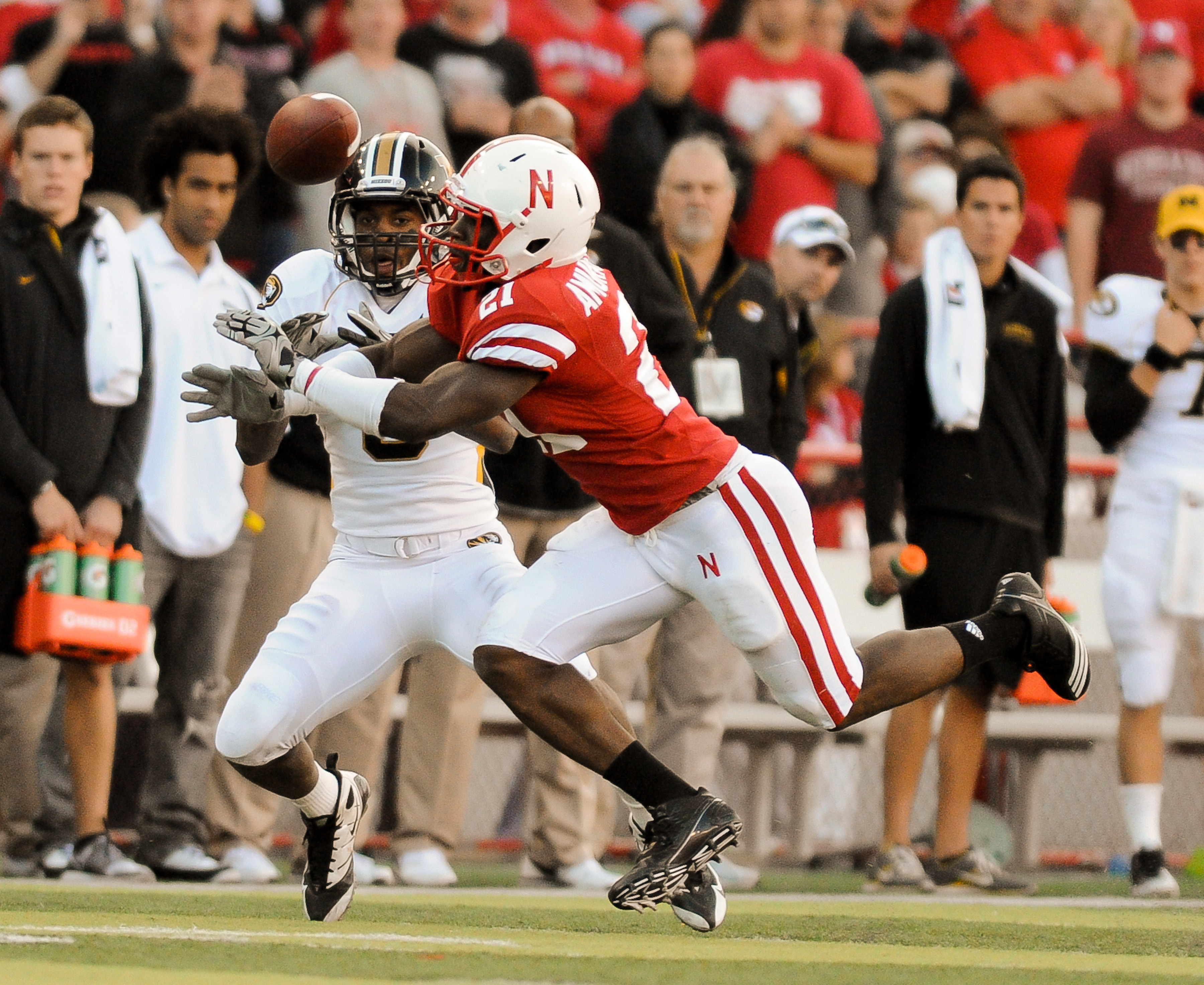 LINCOLN, NE - OCTOBER 30: Cornerback Prince Amukamara #21 of the Nebraska Cornhuskers breaks up a pass intended wide receiver Wes Kemp #8 of the during second half action of their game at Memorial Stadium on October 30, 2010 in Lincoln, Nebraska. Nebraska